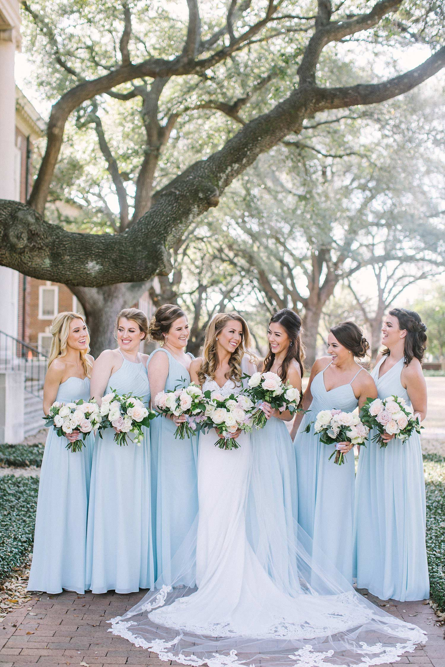 Bridesmaids in dusty blue long dresses