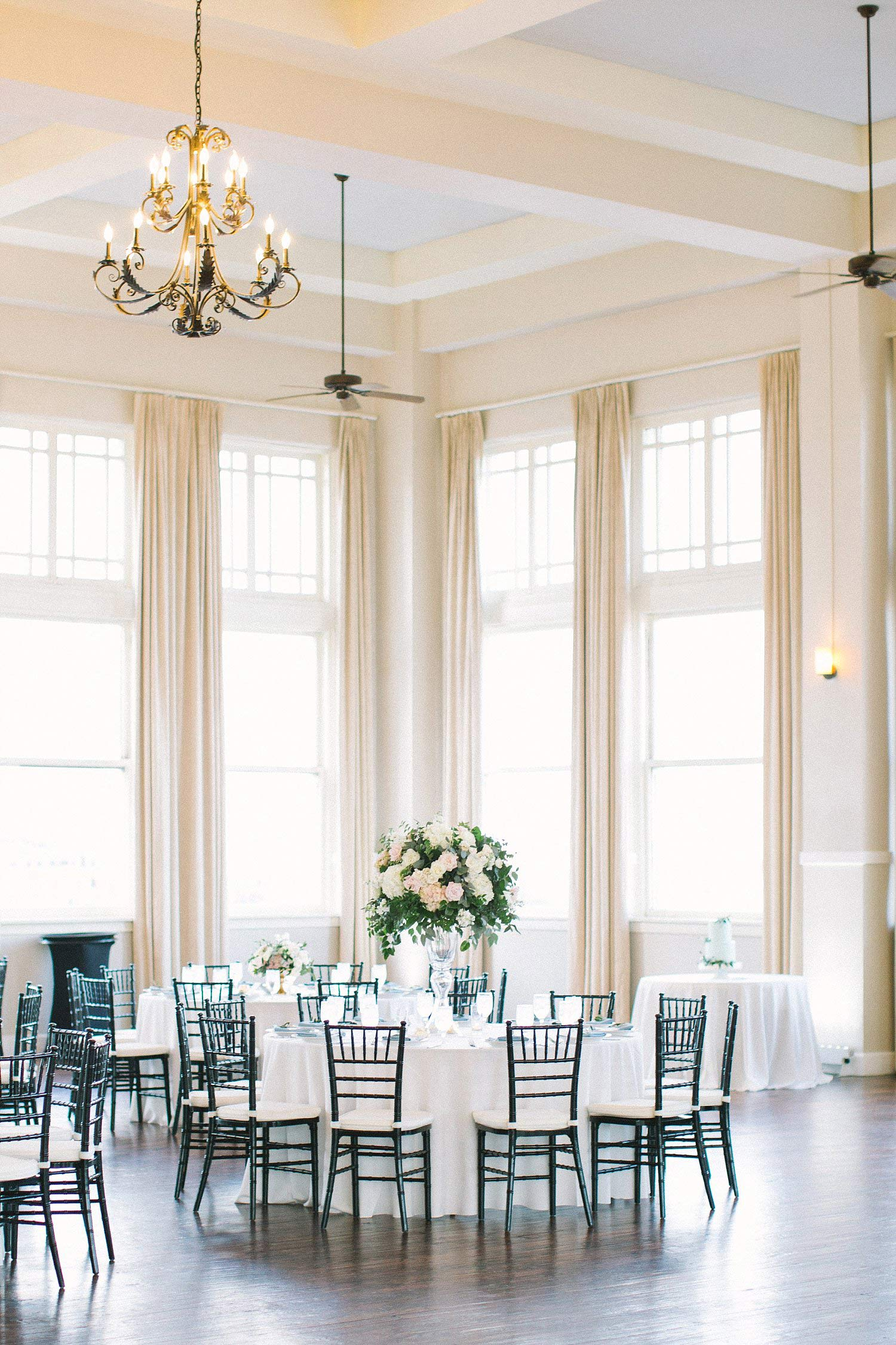 Room on Main reception with tall centerpieces
