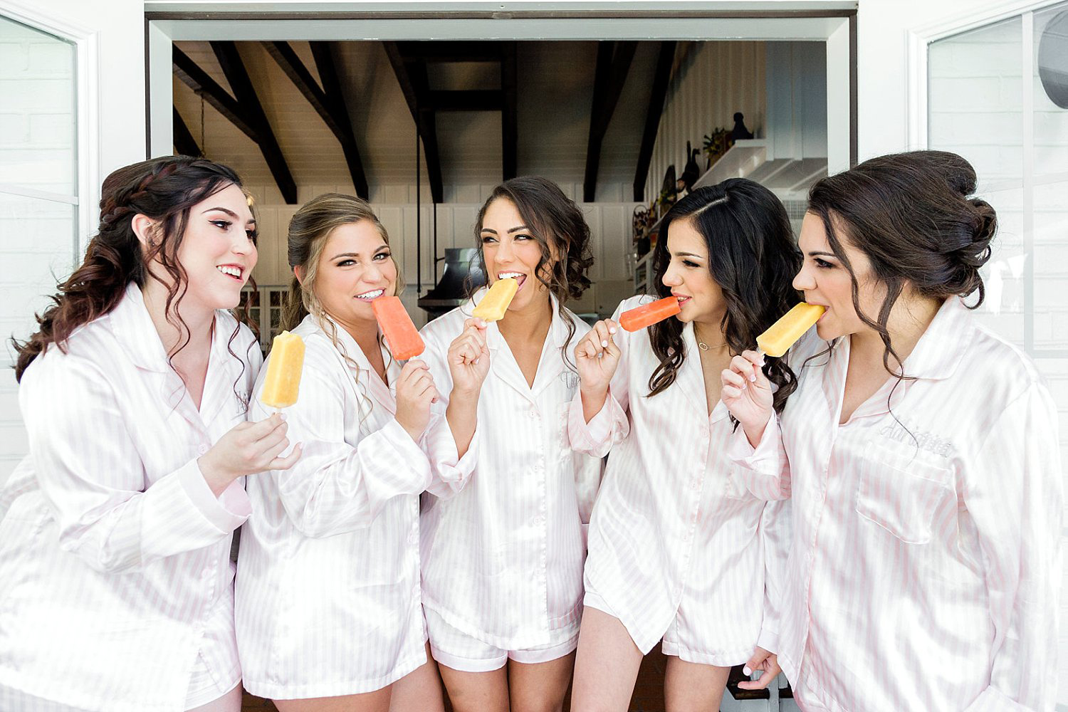 Bridesmaids eating popsicles