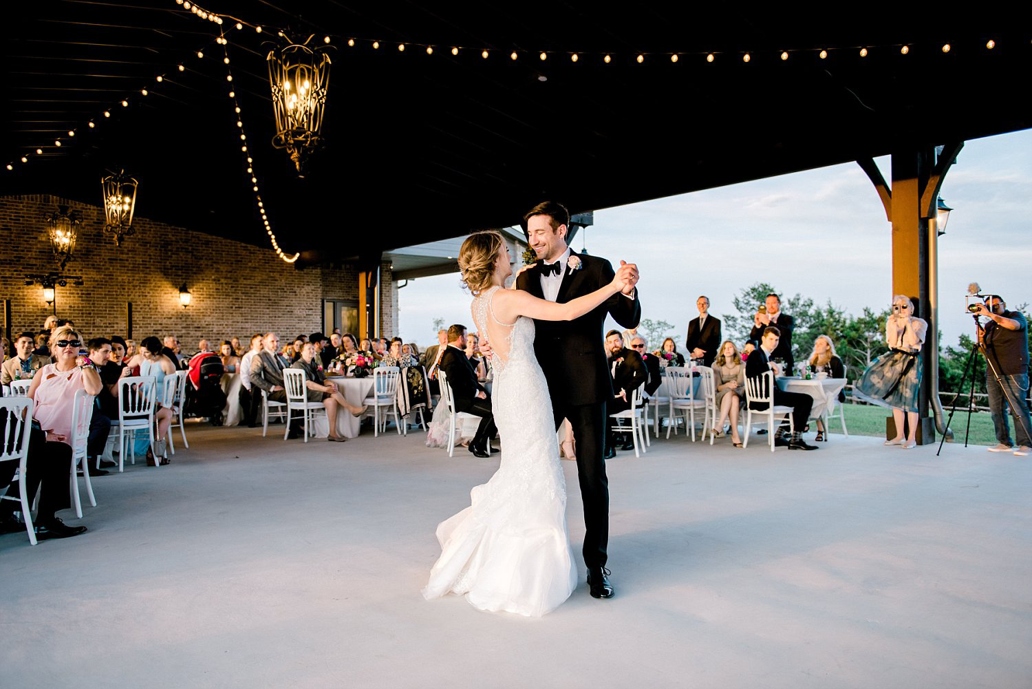 Bride and Groom reception under the pavilion at dove ridge vineyard