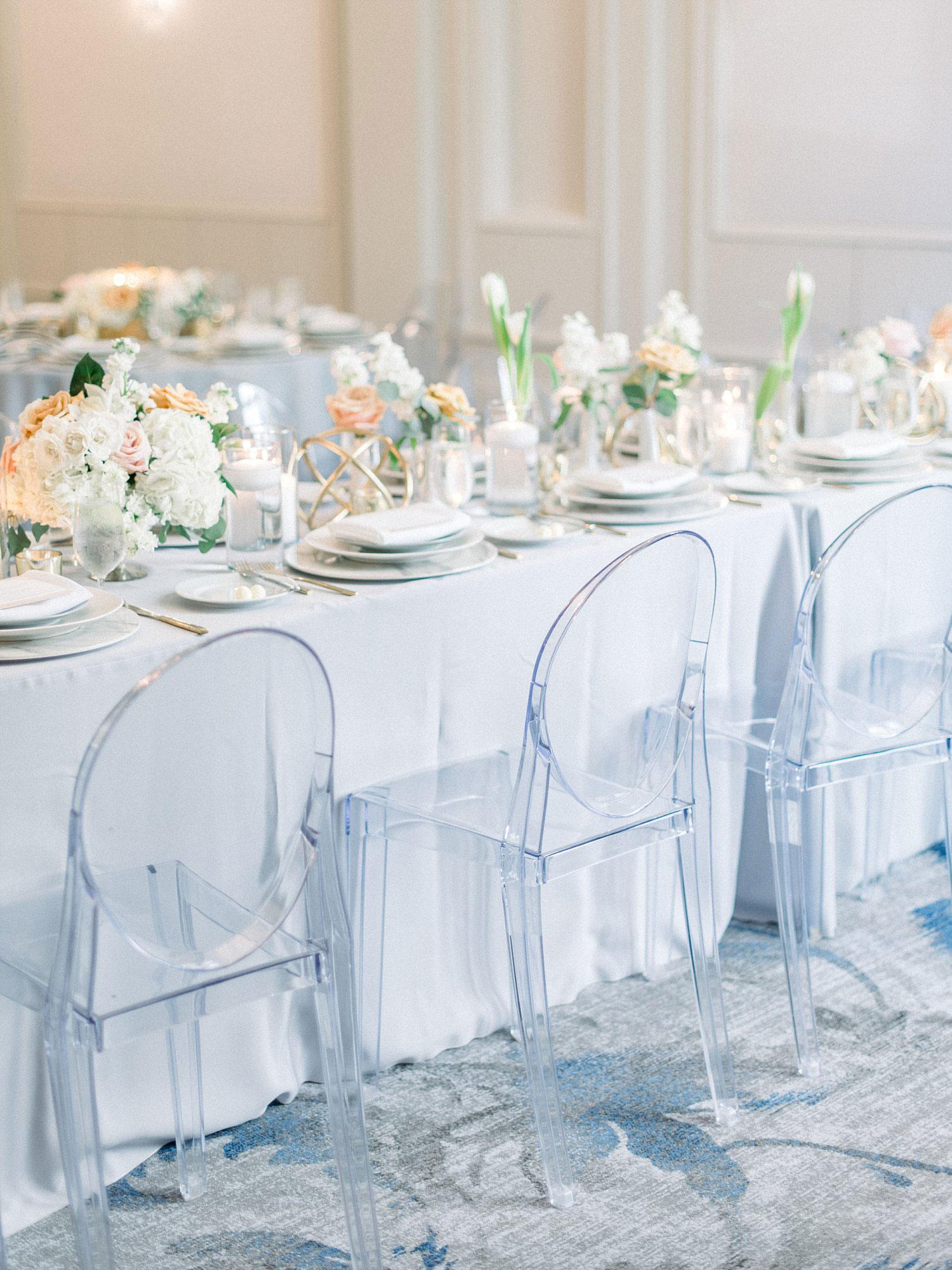 Grey linen and acrylic chair tablescape