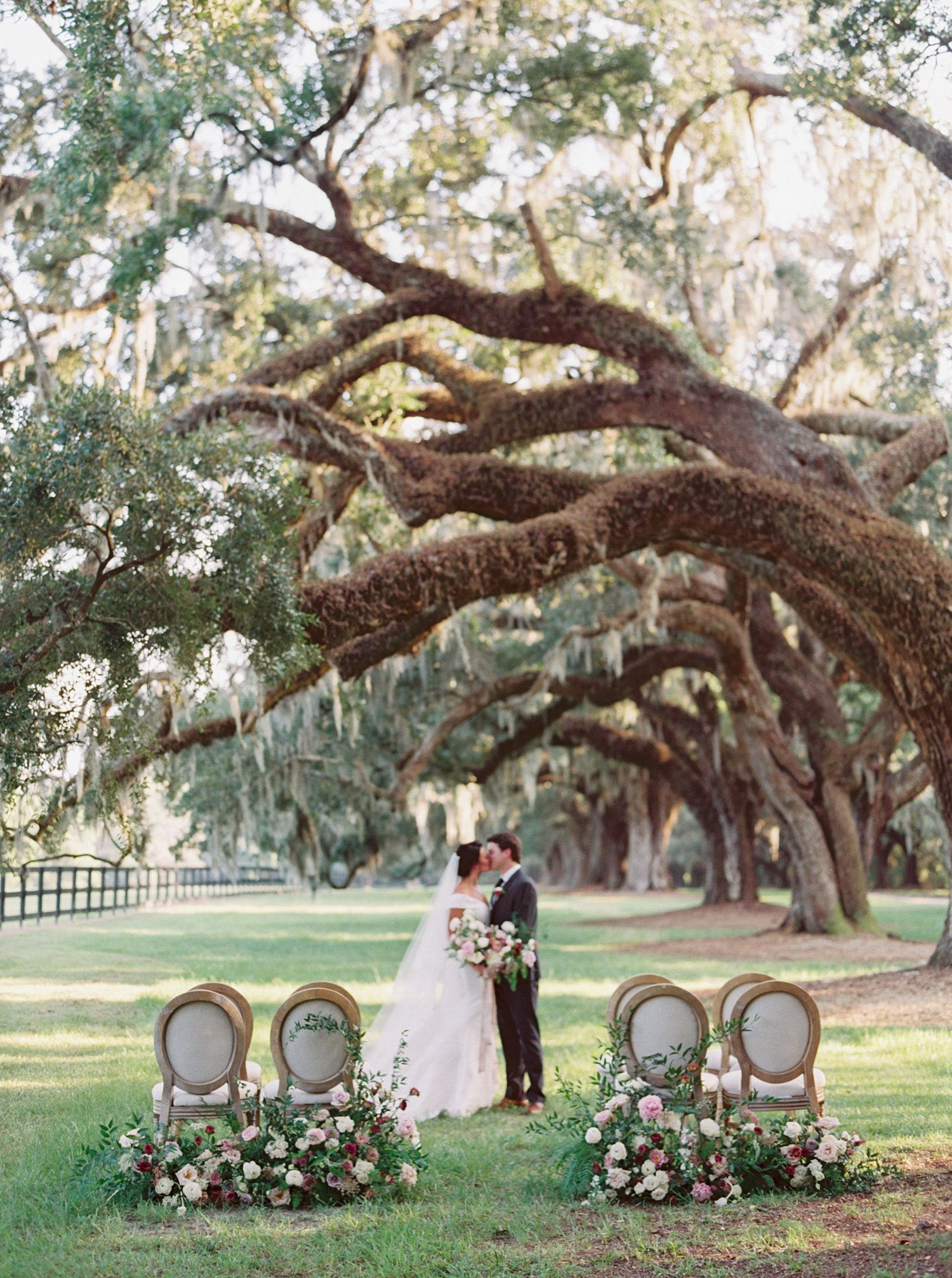 Bride and groom ceremony in front of Spanish Moss Trees in South Carolina Wedding