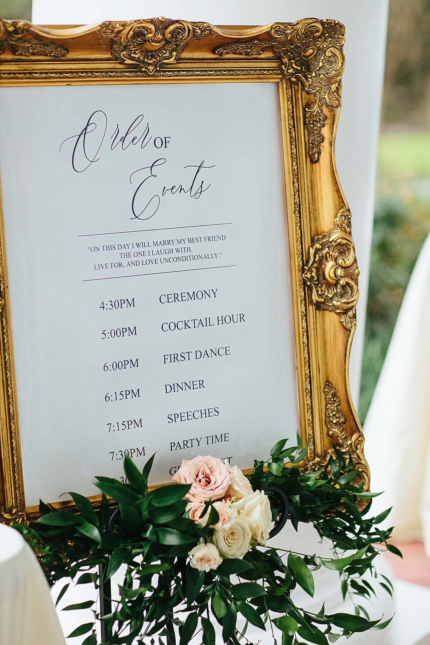 Wedding timeline sign with a gold frame