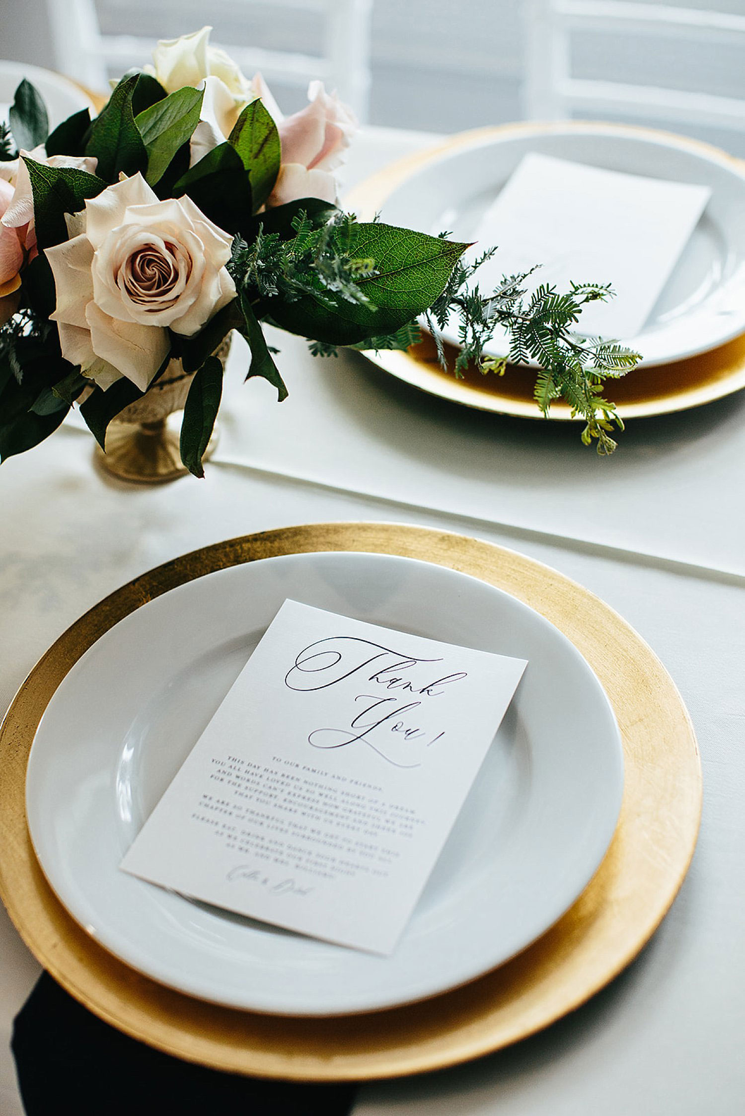 Gold Charger with white menu and navy napkin