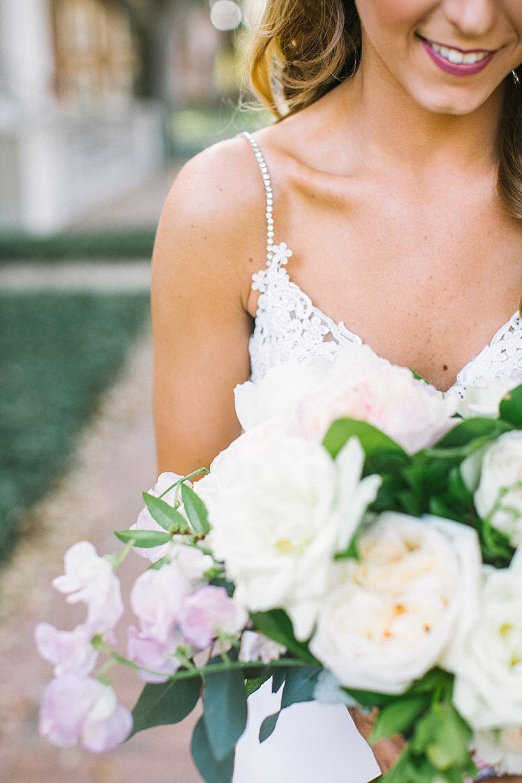 Bride holding a blush and white bouquet