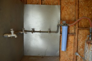 The faucets where Ana's residents would have to fill up jugs in order to have clean water in their homes