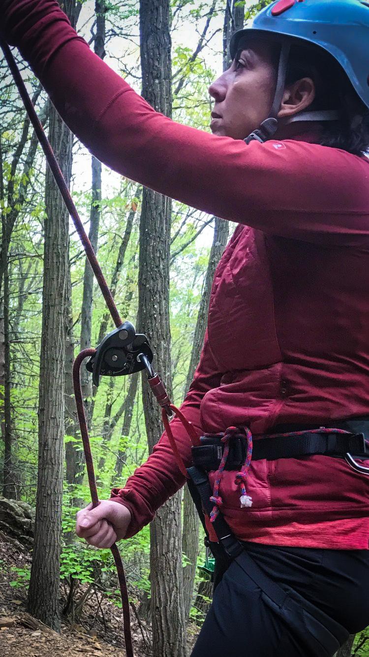A client belays Climbing Guide Matt Shove with a GriGri +