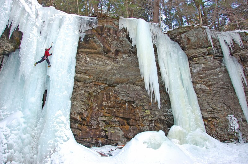 Ben Carlson bridging the gap on the final pitch of Buttermilk Falls, Catskills NY. Photo: Bill Baer.
