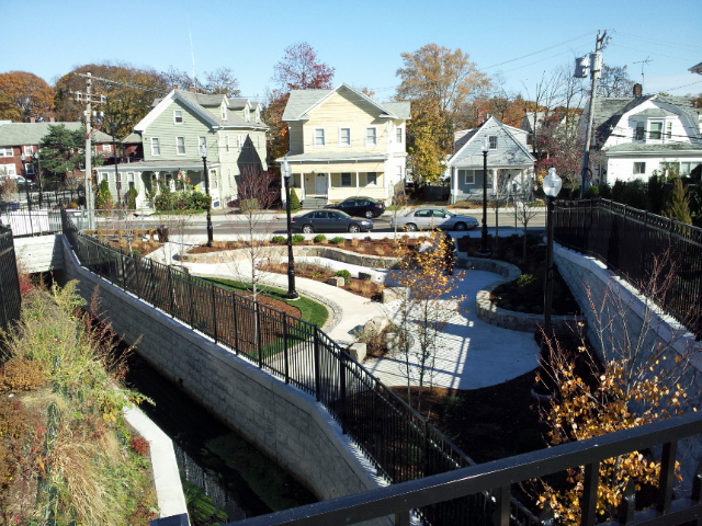 As part of the design team for the Town Brook Daylighting project in the City of Quincy, we designed two strolling gardens focused on the open channel, incorporating interpretive signage about the site history and recreated smelt habitat as well as locally sourced reclaimed granite blocks.