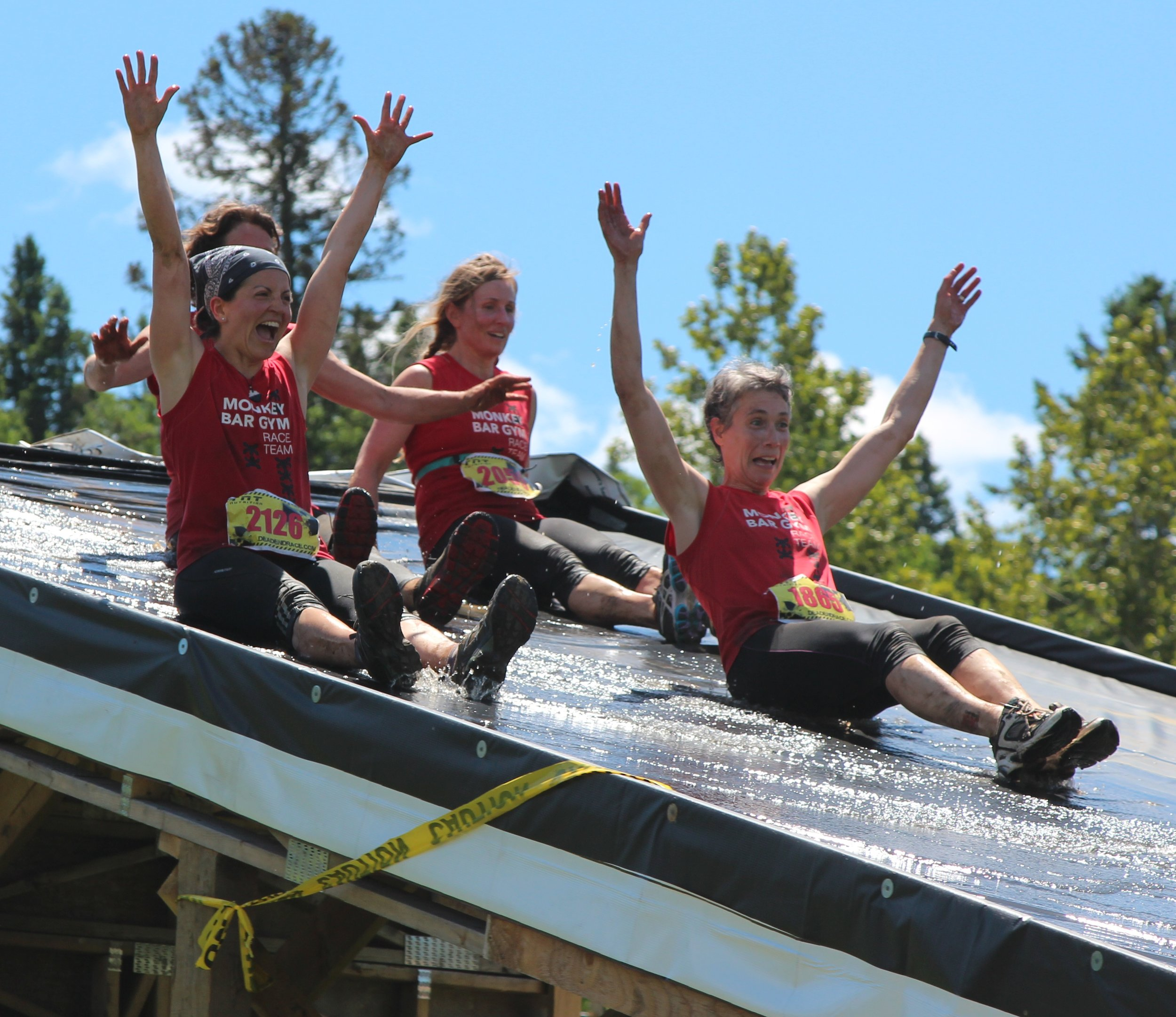 Strong women having fun at a obstacle race event.