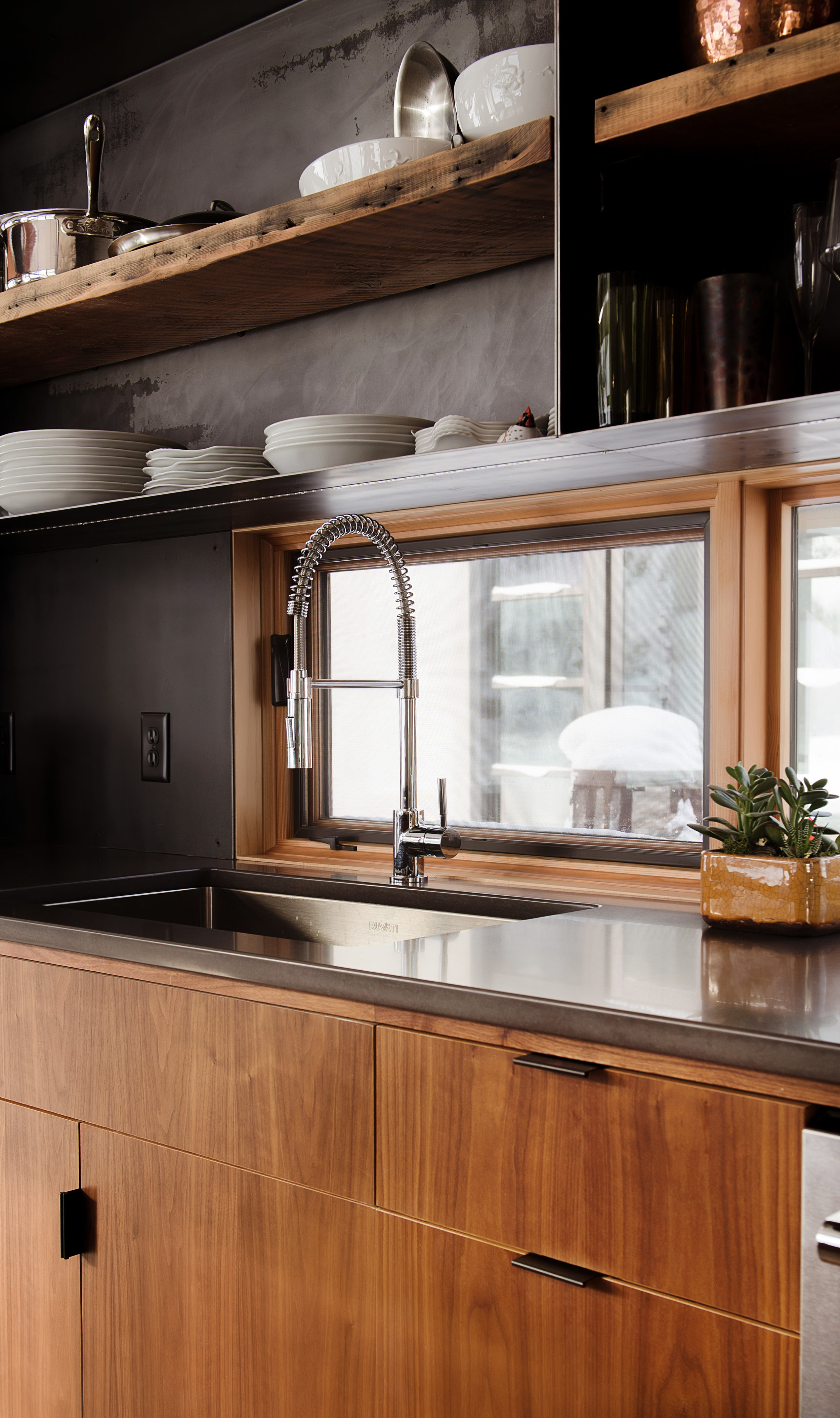 | Walnut Cabinetry | Steel Casework | Reclaimed Shelving |