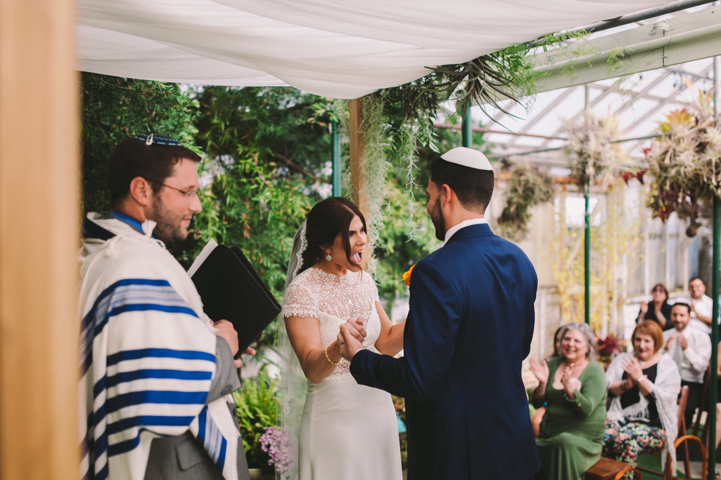 Bride & Groom Under Chuppah at Shelldance Orchid Gardens Pacifica