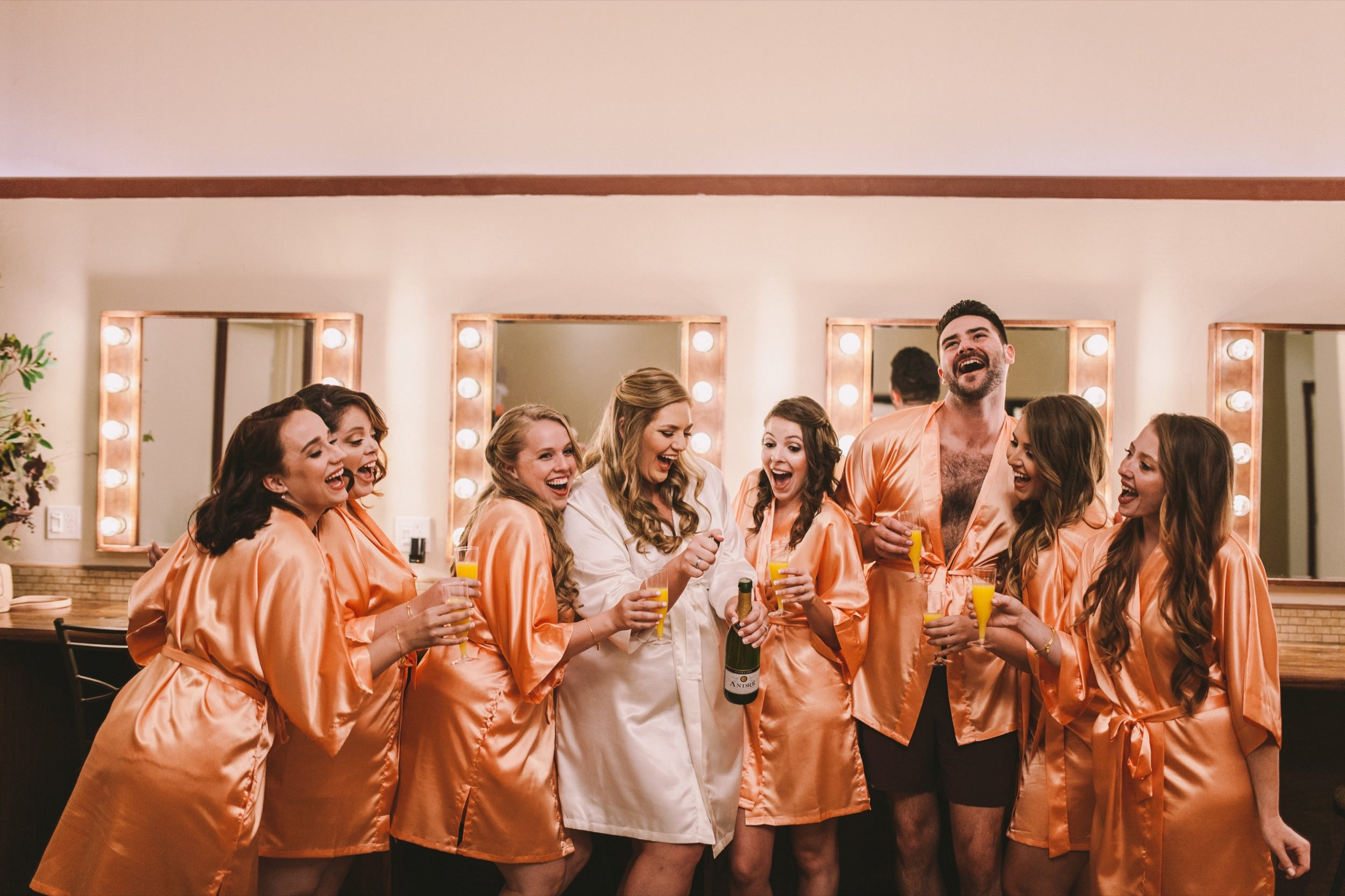 Bridesman Matching Peach/Orange Robes with Bridesmaids Wedding Prep Shots