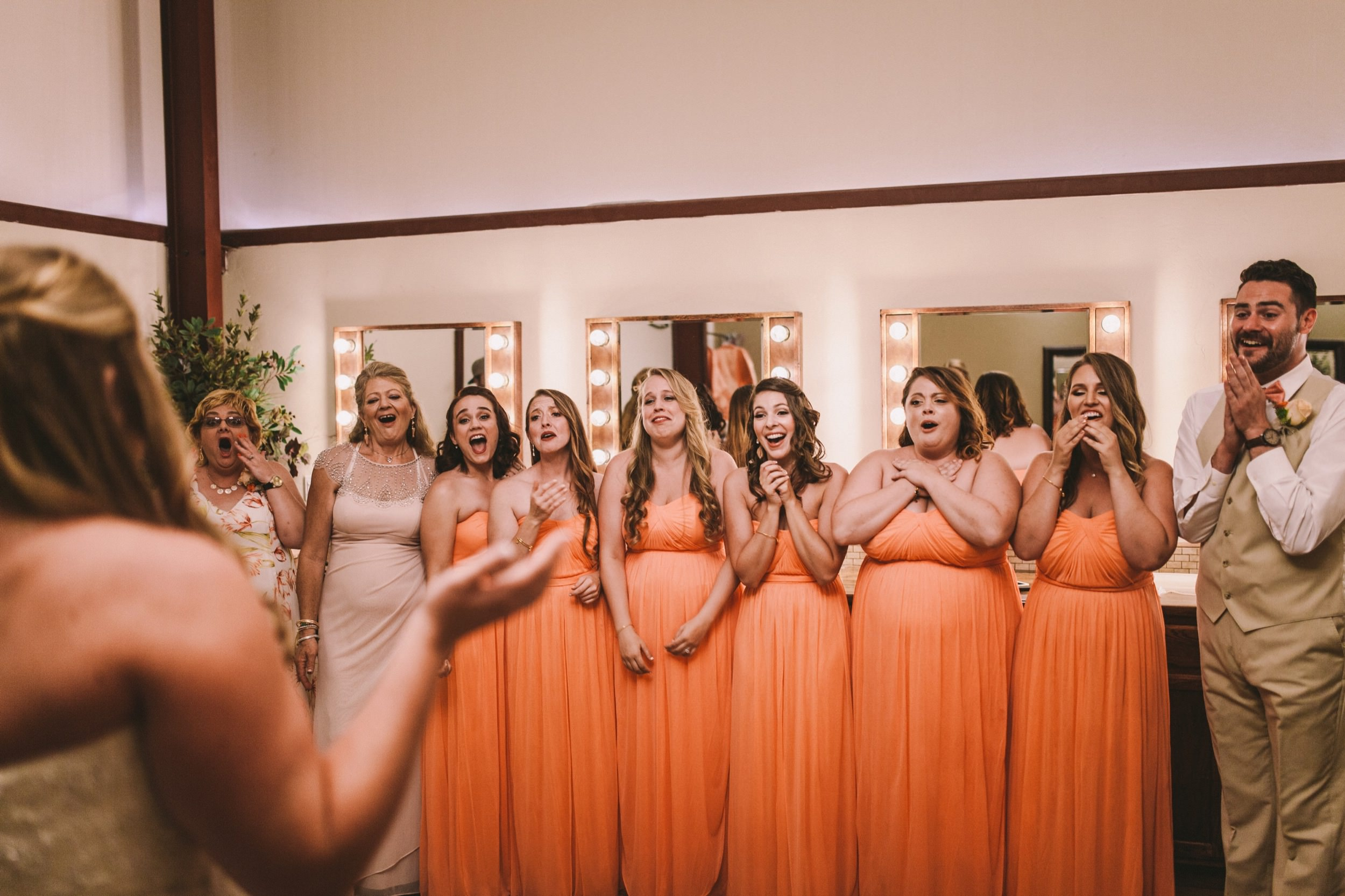 Bride's first look with Bridesmaids and Bridesman