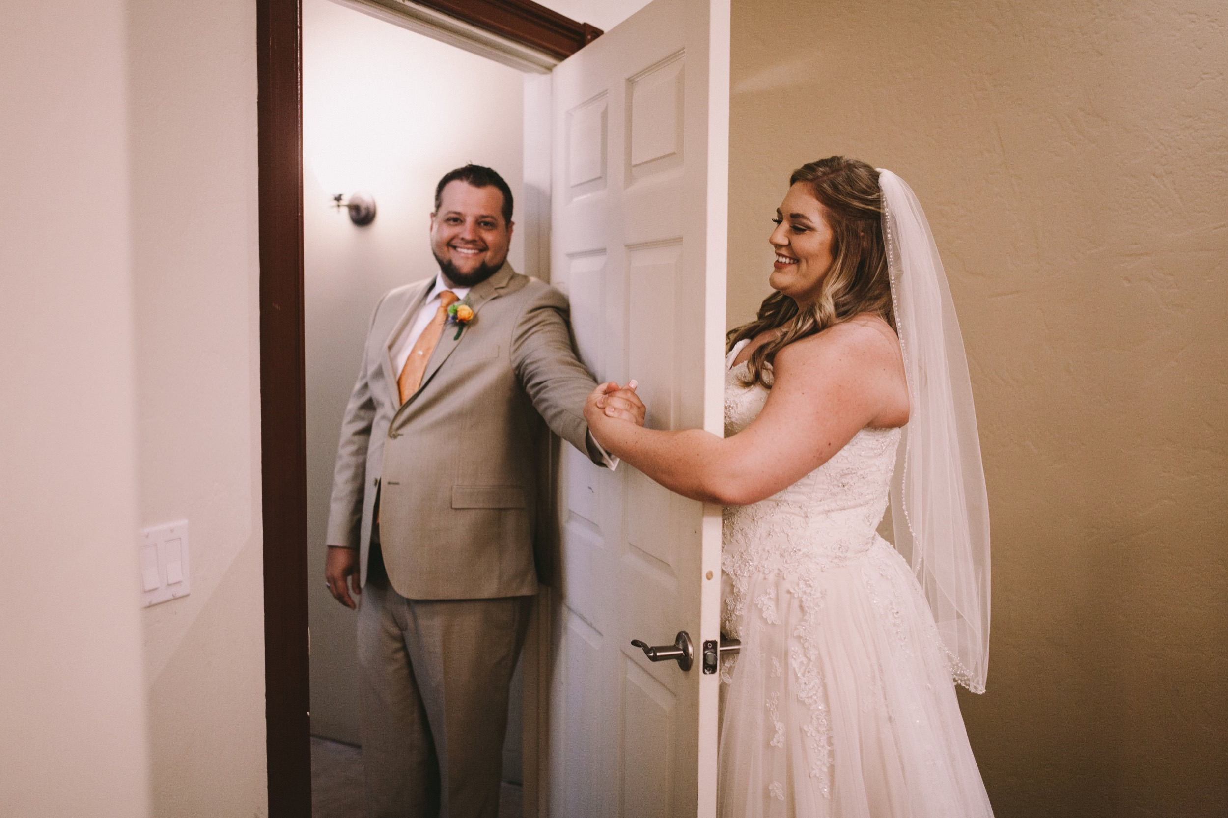 Toca Madera Winery Wedding Holding Hands at Door Semi-first Look