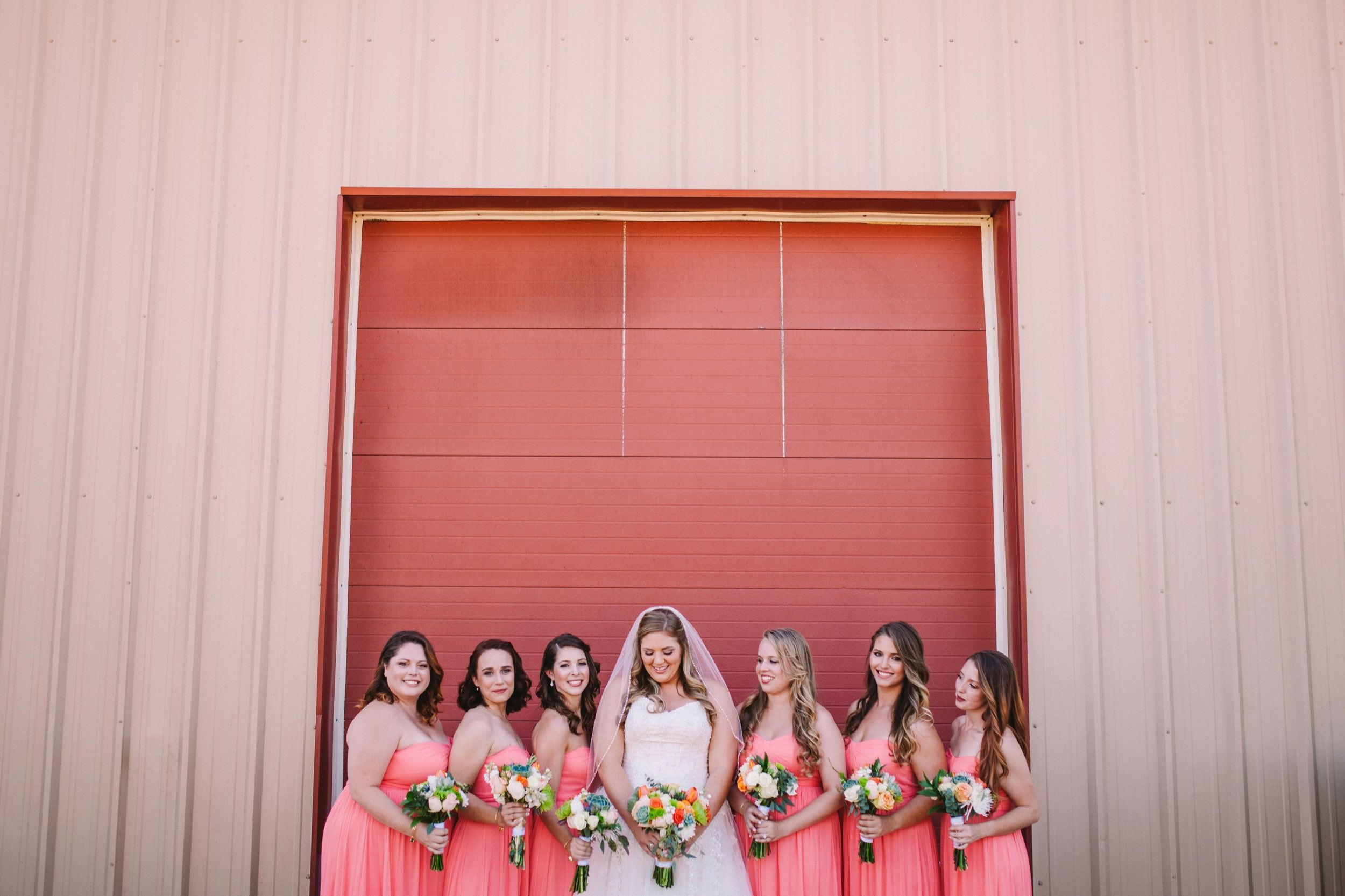 Colorful Pink and Orange Wedding - Bridesmaids in Pink Group Shot, Standing in front of Red/Pink Door