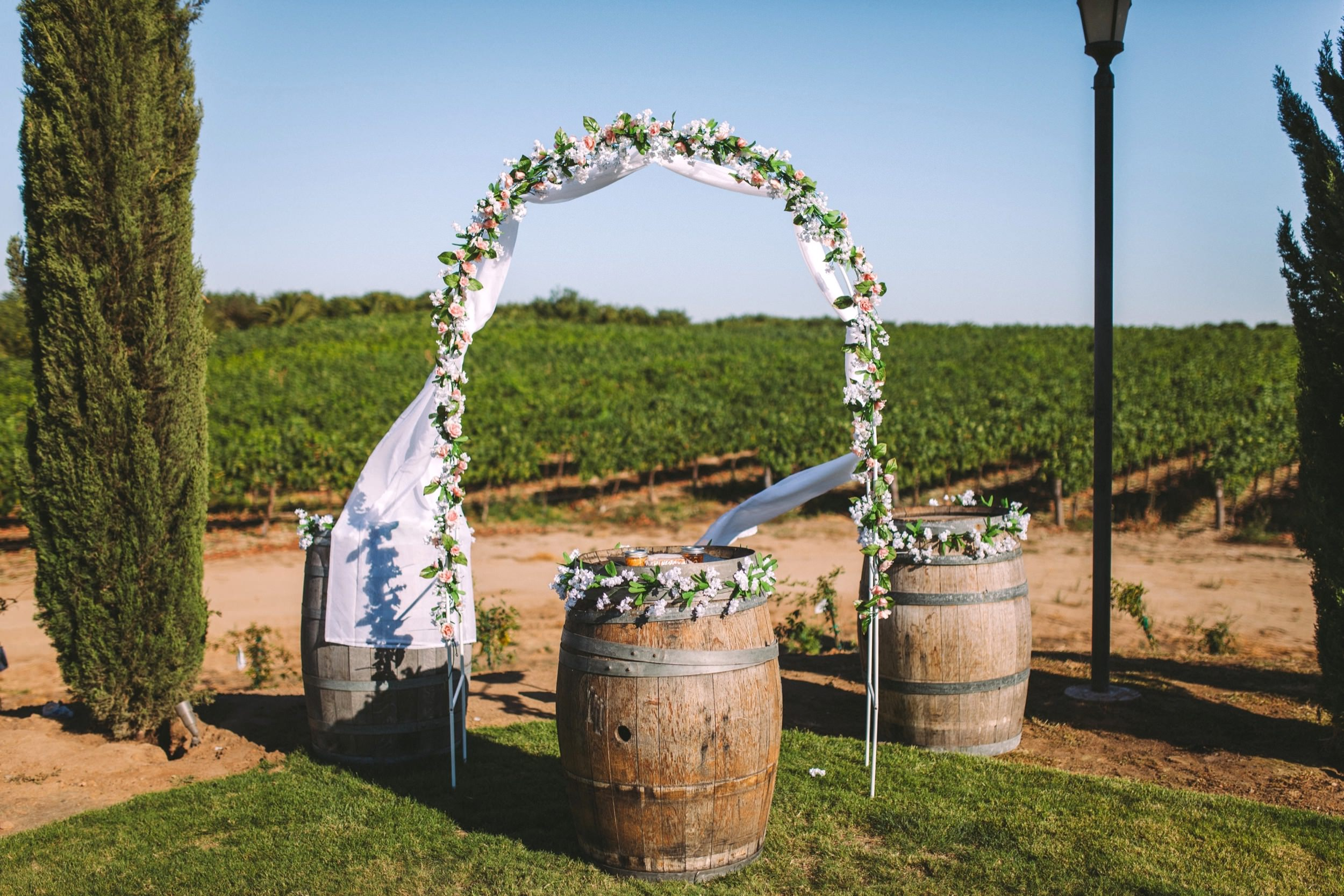 Toca Madera Winery Vineyard Wedding Flower Archway & Wine Barrels Outdoor Ceremony