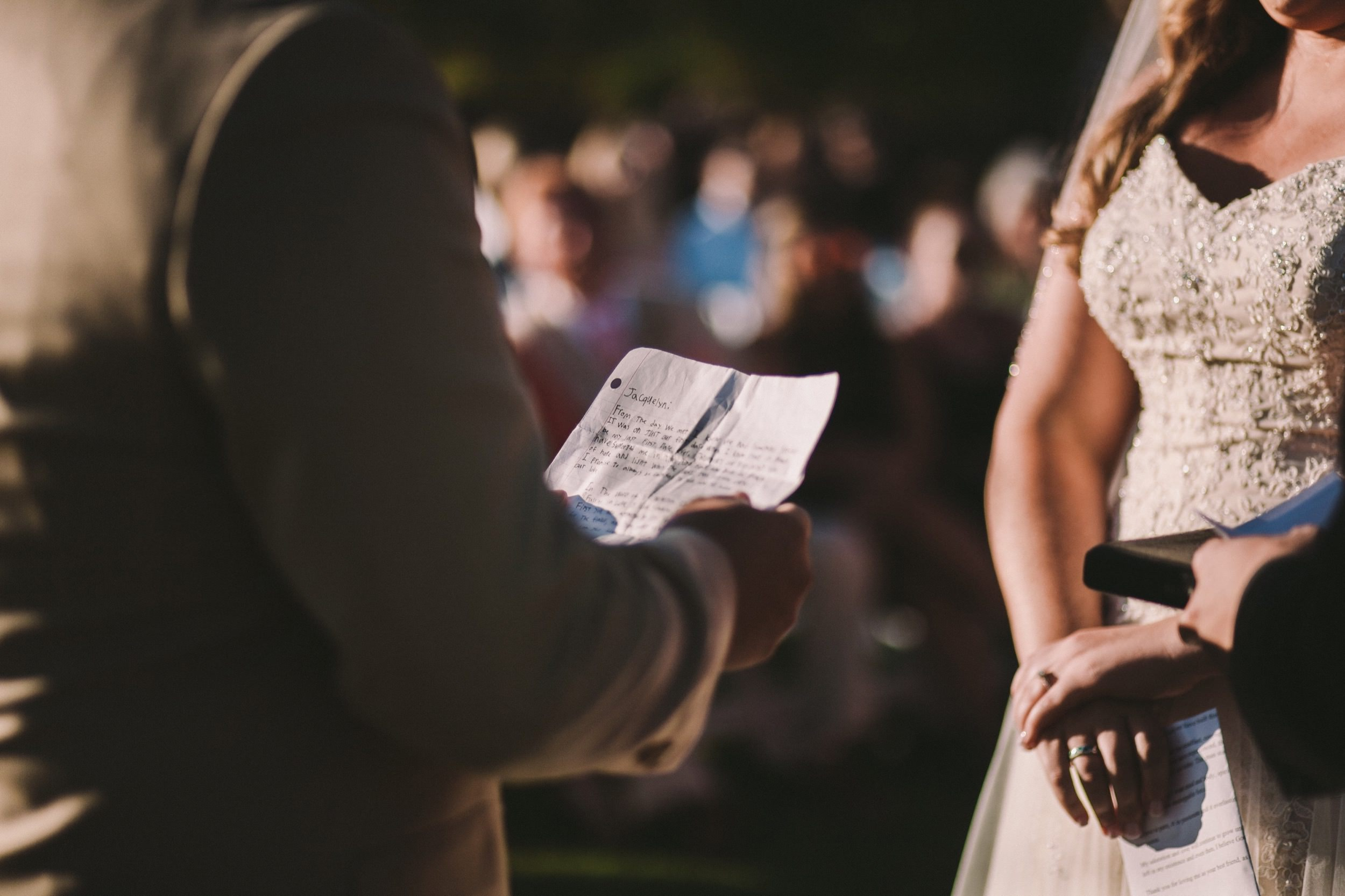 Grooms Personal Hand Written Wedding Vows Being Read During Outdoor Ceremony