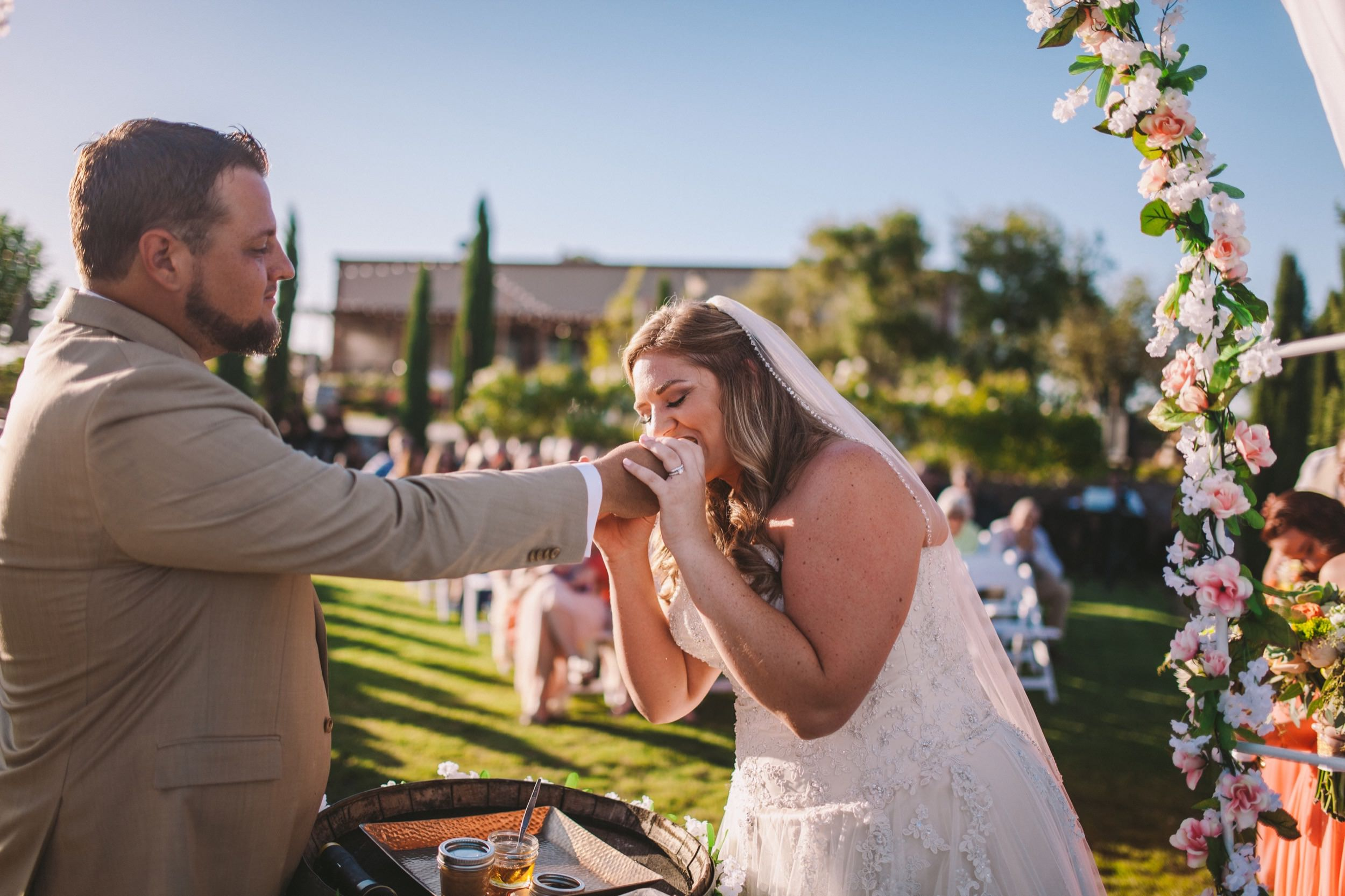 Bride & Groom Feeding Each Other Peanut Butter & Honey Sandwich During Wedding Unity Ceremony