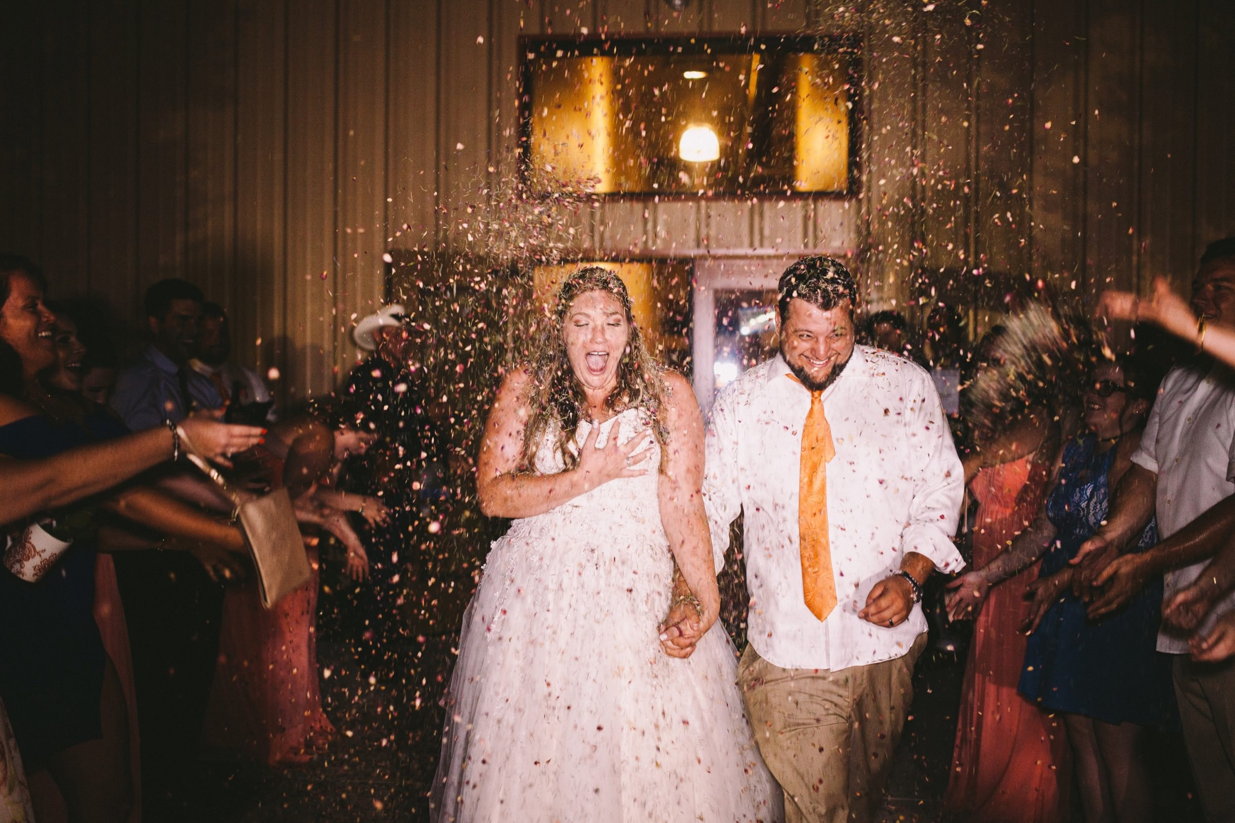 Toca Madera Winery Wedding Exit with Handmade Rose Petal Confetti