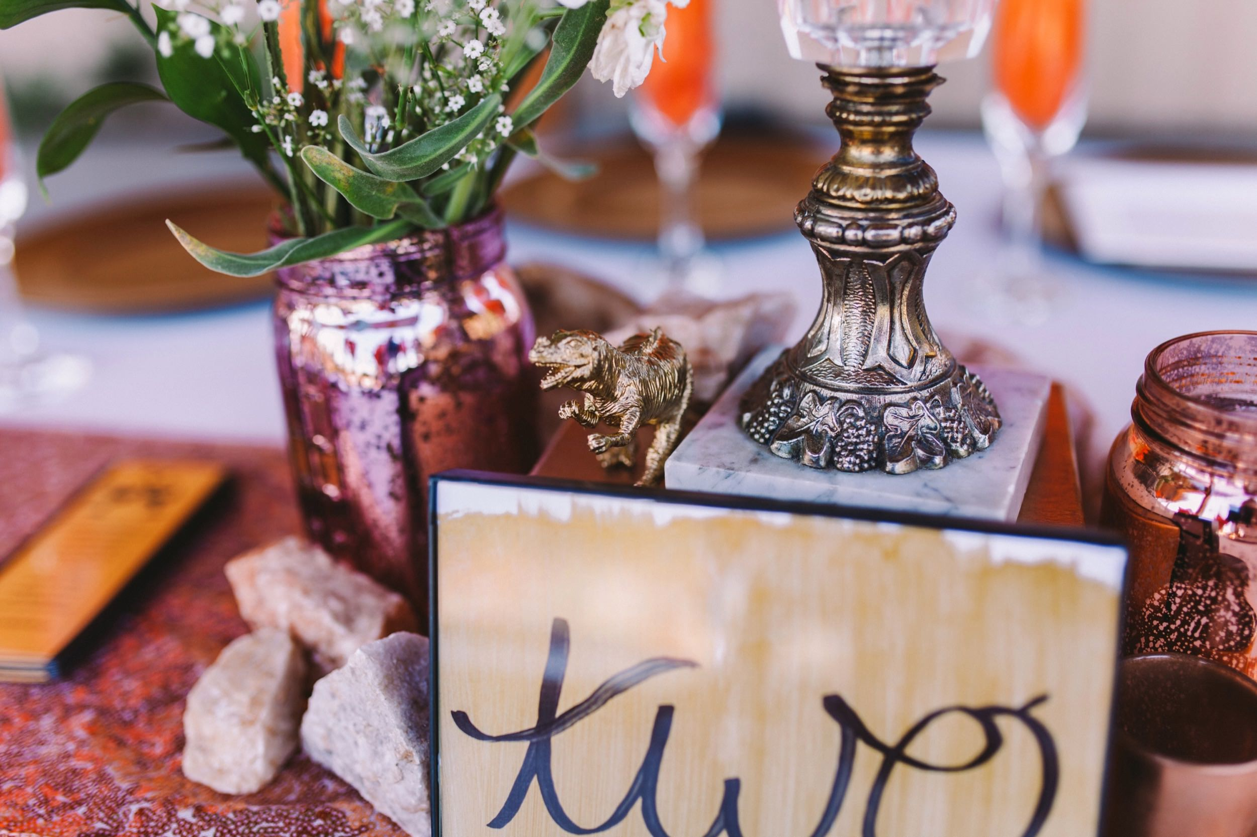 Golden Dinosaur Centre Pieces - Pink and Orange Wedding Outdoor Reception Theme