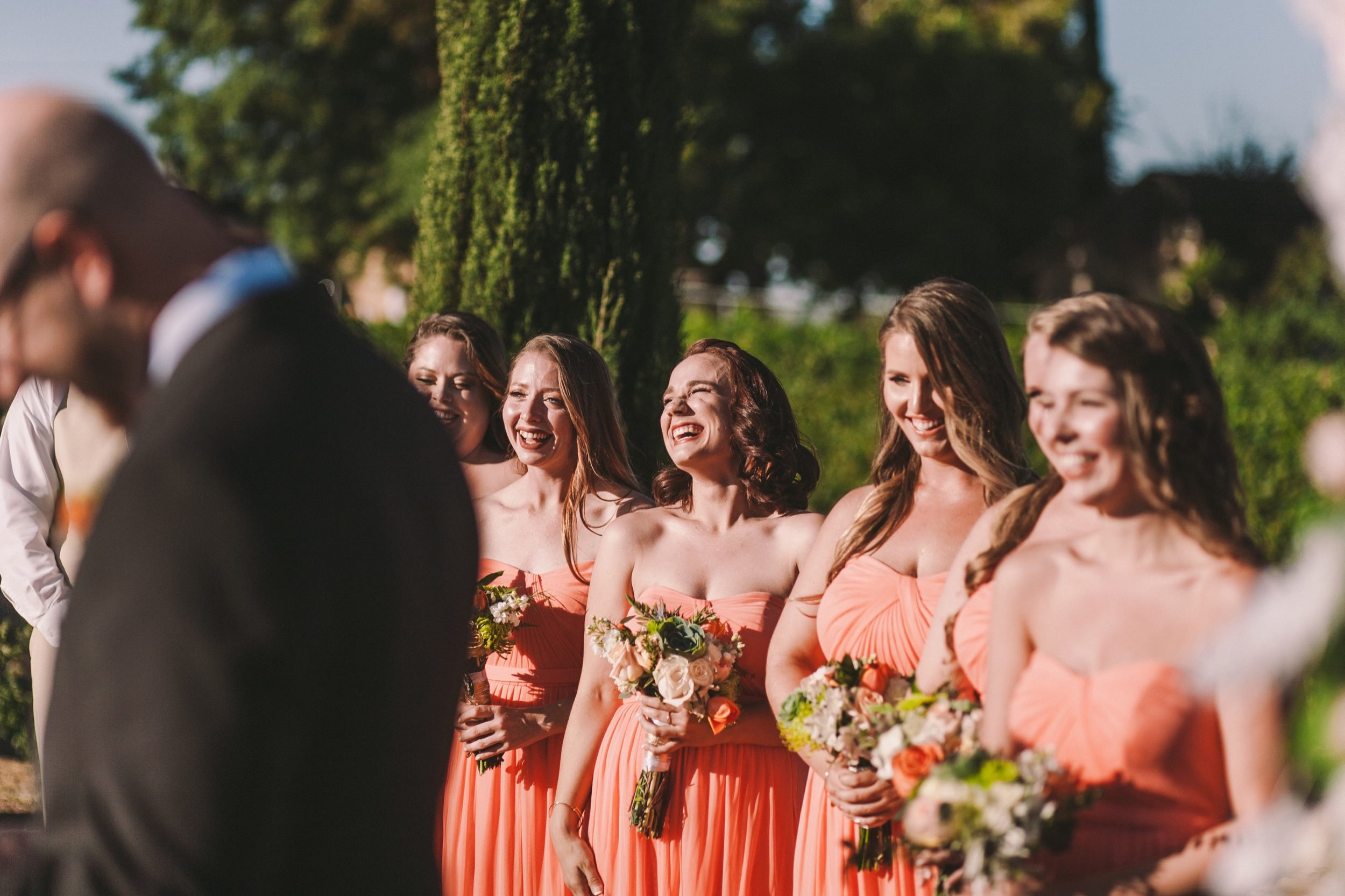 Bridesmaids Laughing During Outdoor Wedding Ceremony