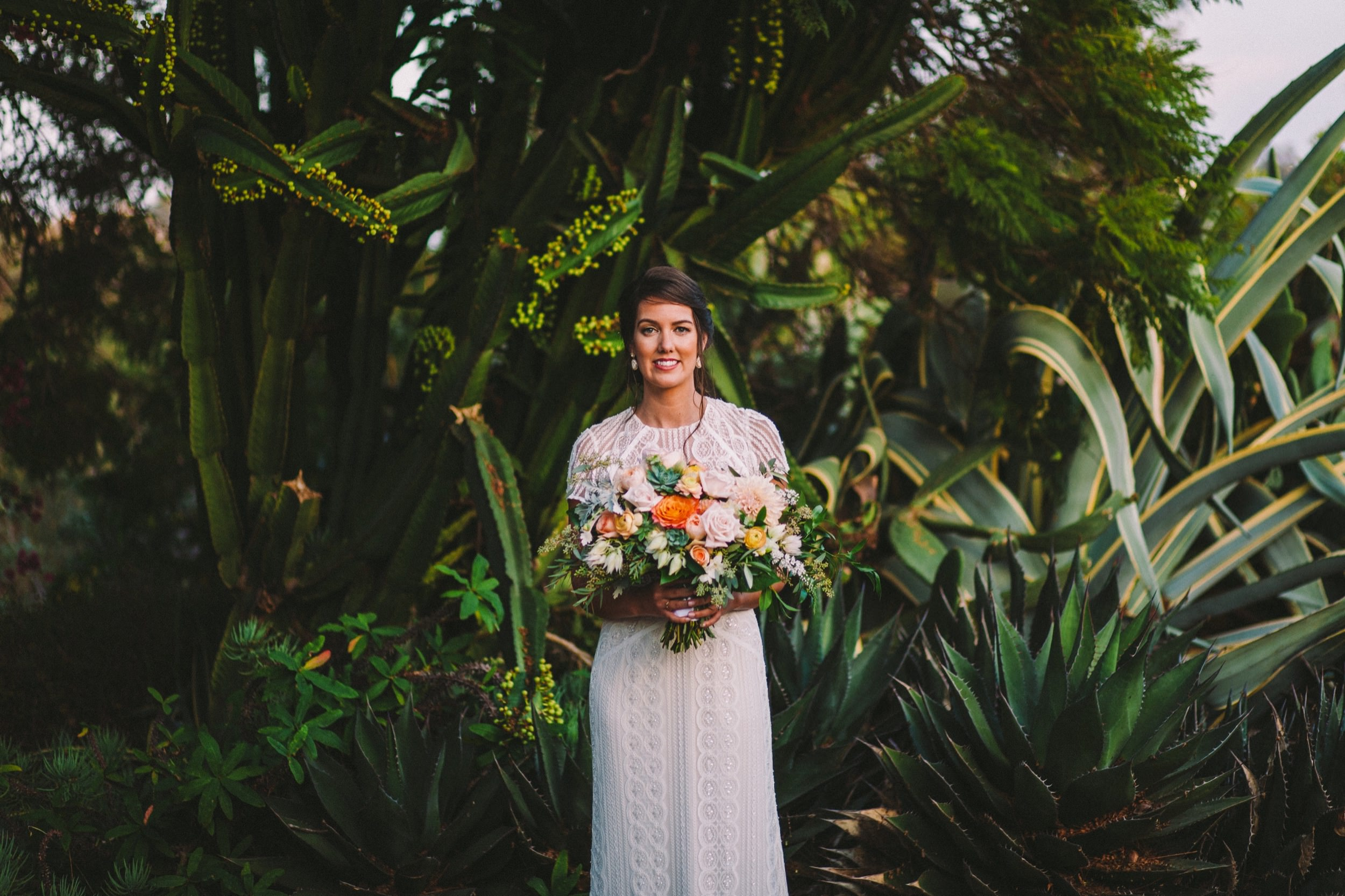 Bride Holding a Bouquet by Flower Frenzy in Encinitas
