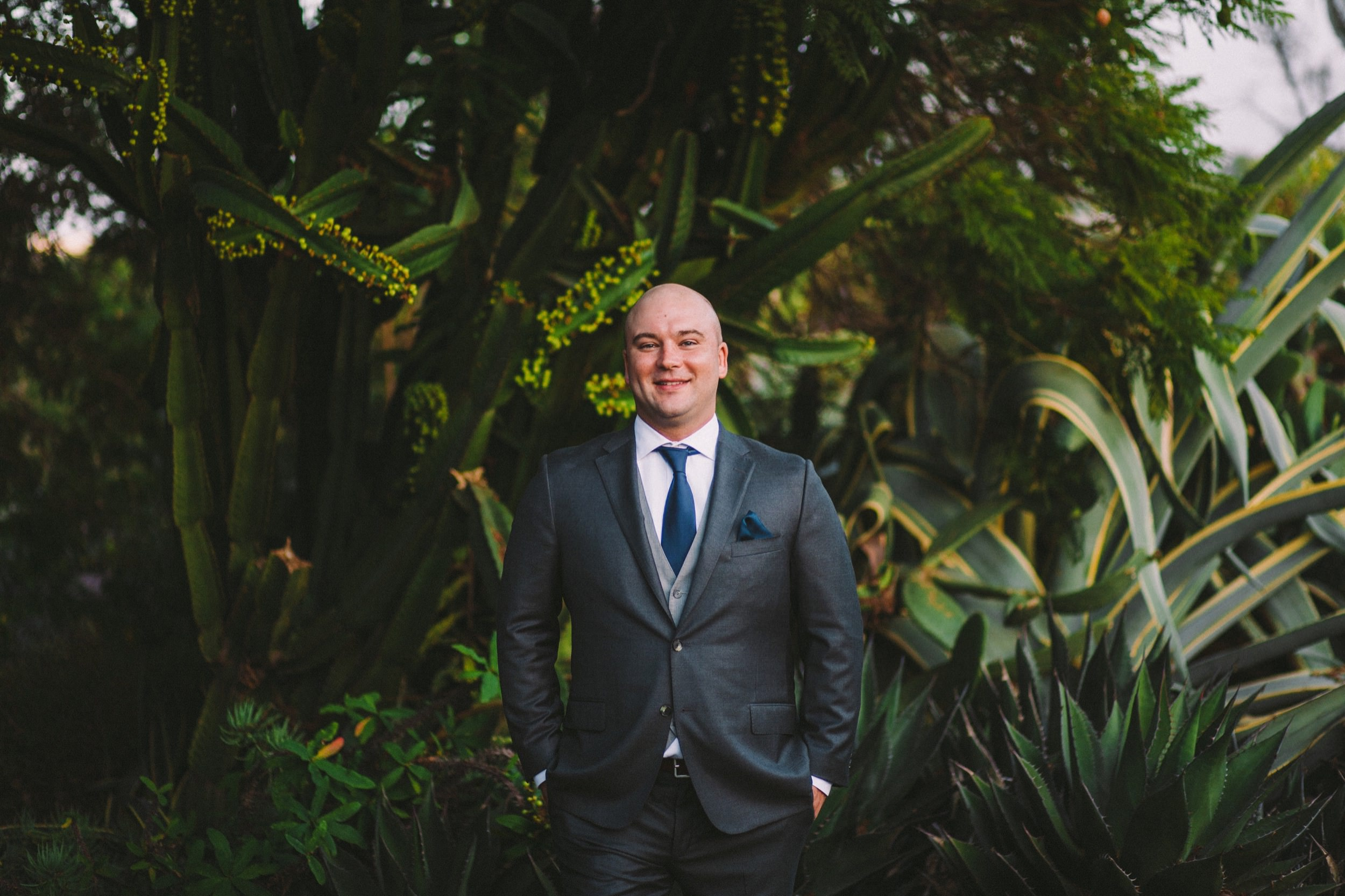 Groom Wearing Hickey Freeman Navy Suit
