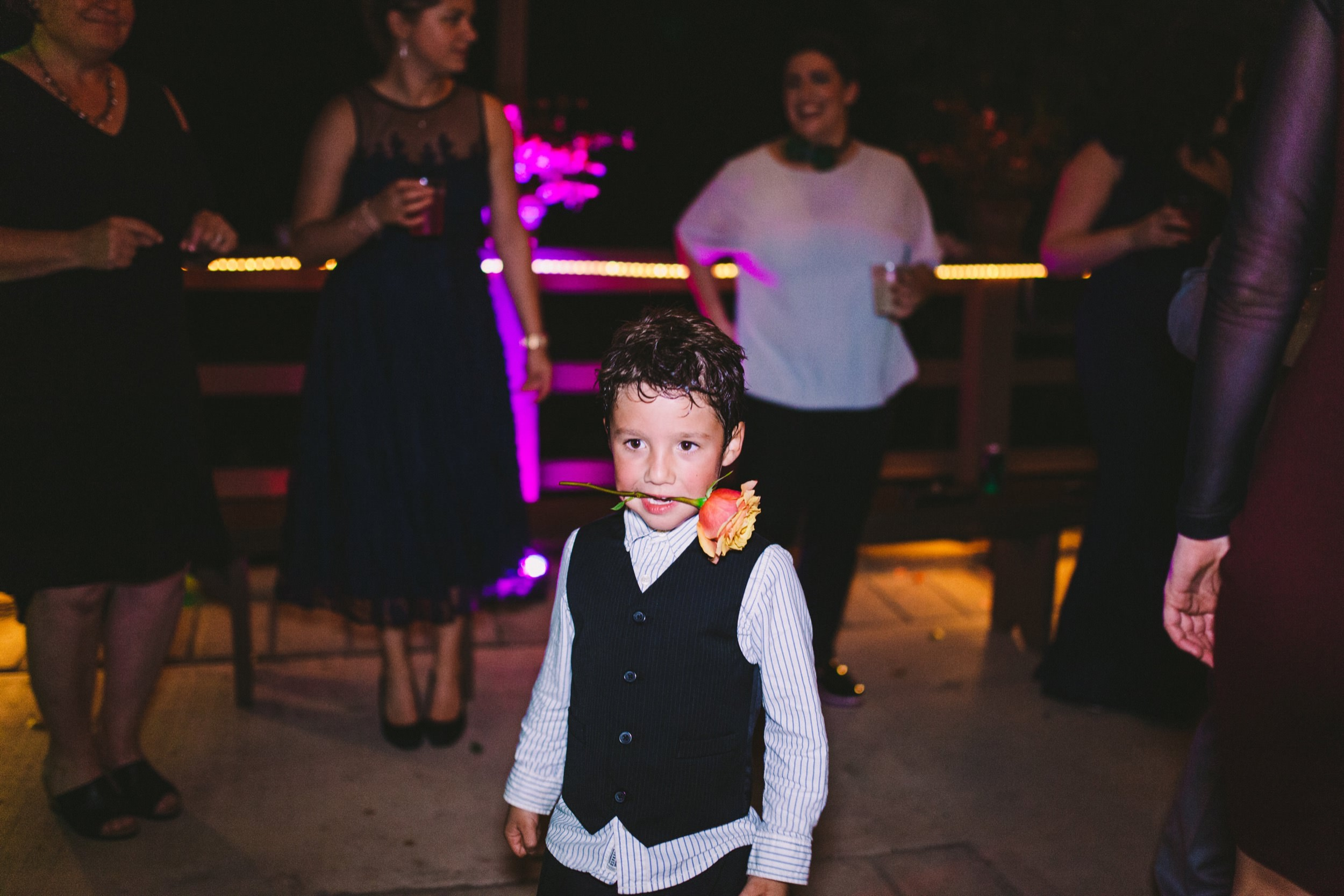 Cute Kid Dancing with Rose in Mouth at Wedding