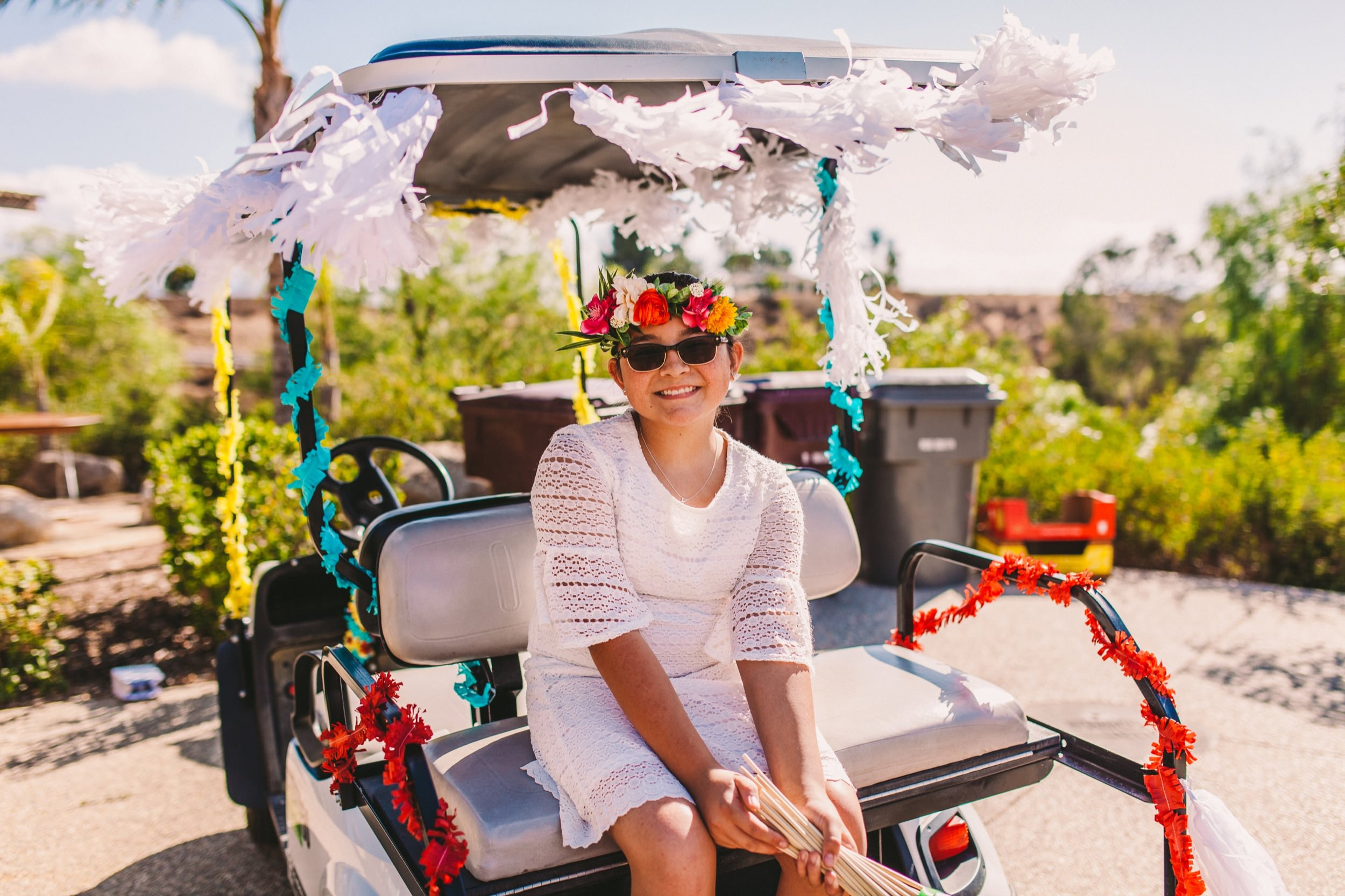 Colorfully Decorated Golf Cart for Wedding Day Transportation