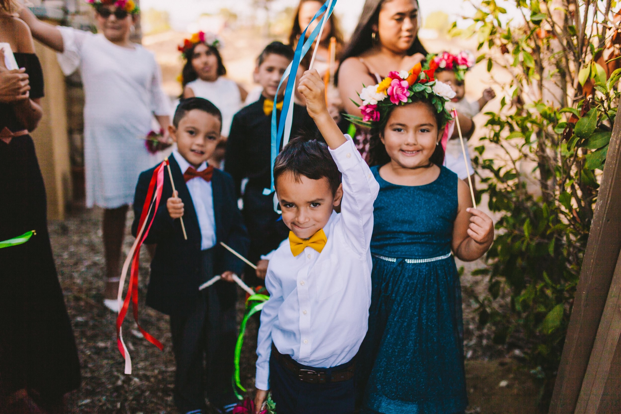 Flower Girls & Boys with Colorful Ribbon Wands and Vibrant Flowers Crowns