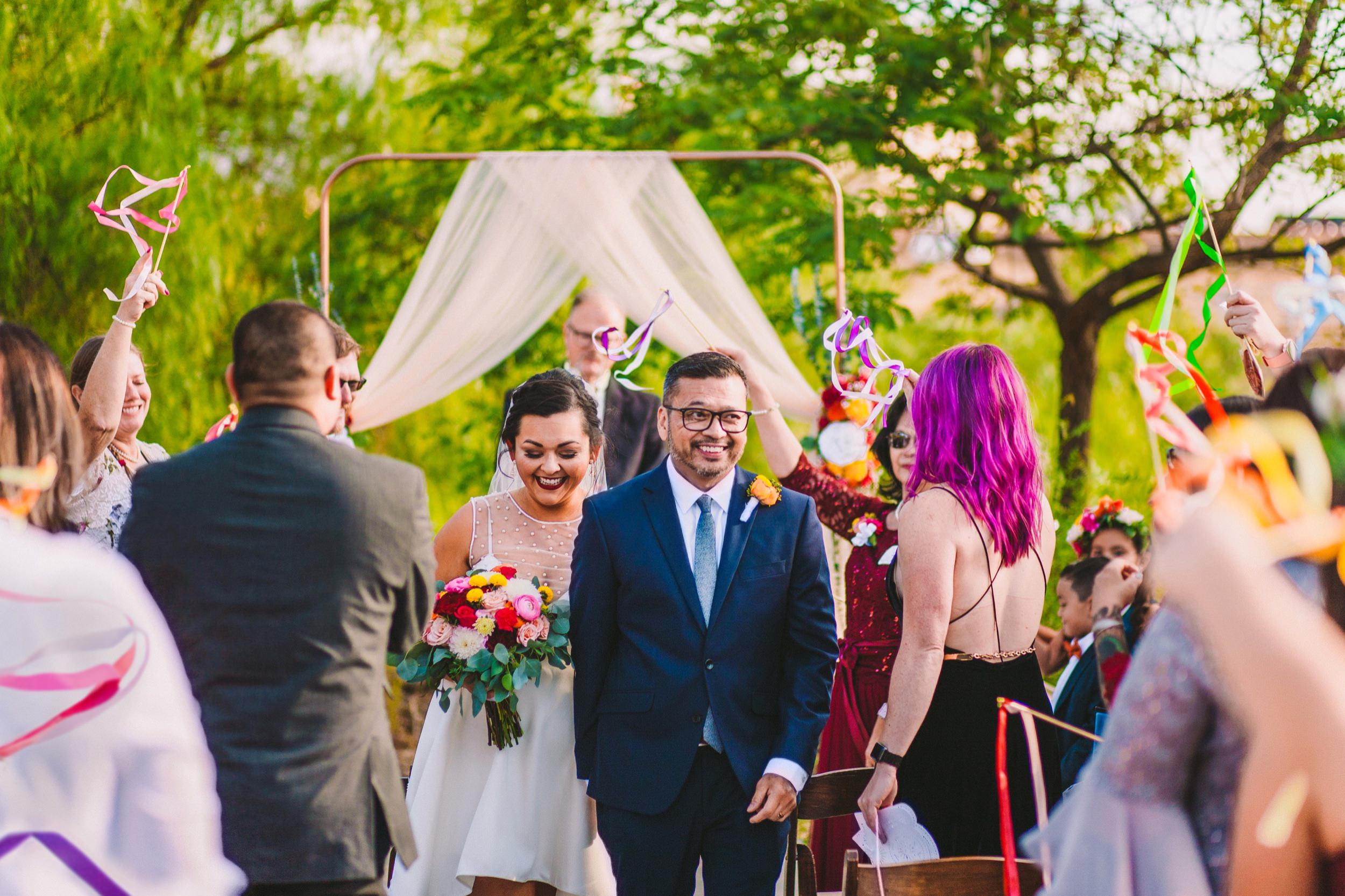 Joyful Wedding Ceremony Exit with Colorful Ribbon Wands