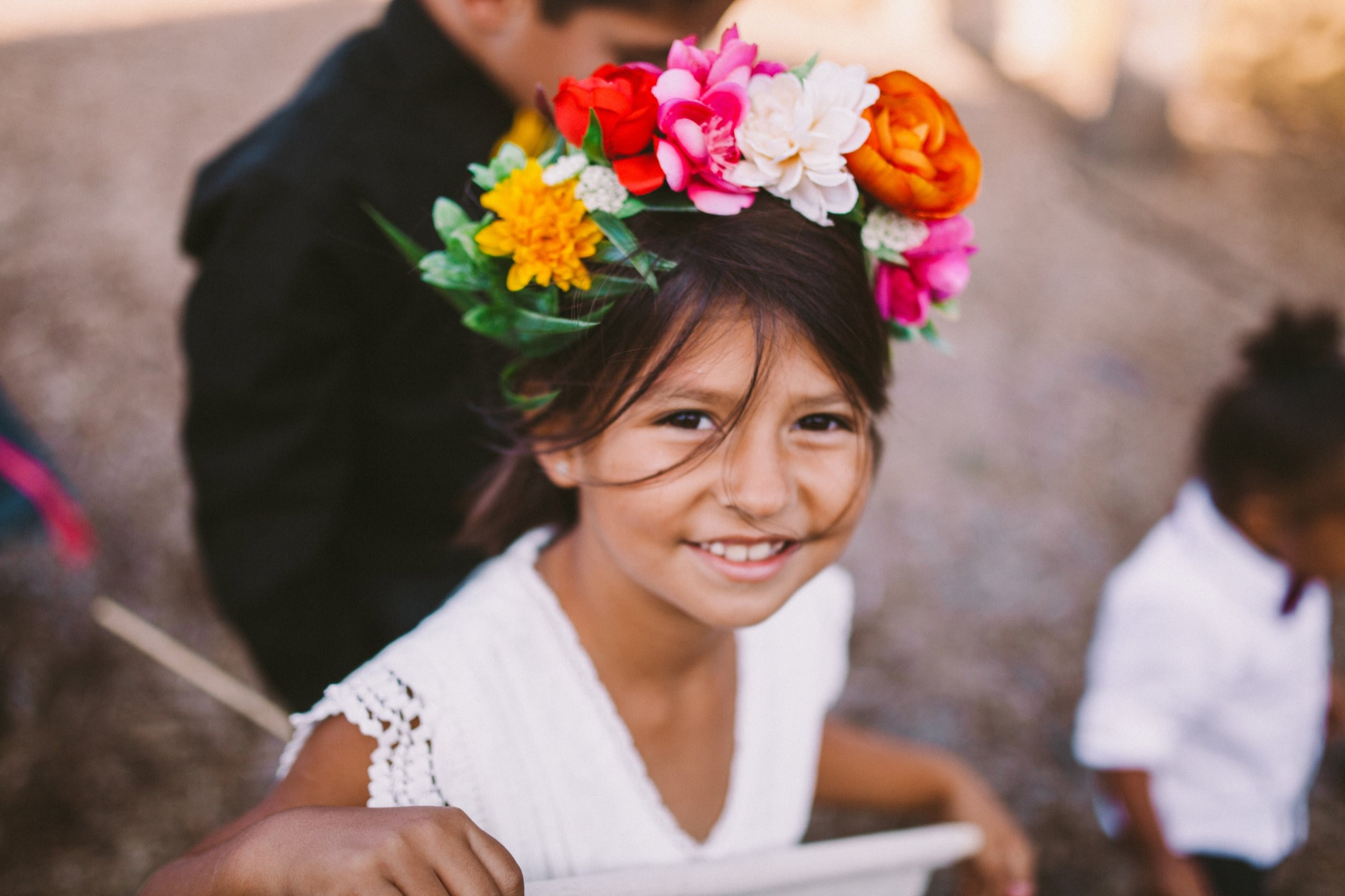 Flower Girl with Vibrant, Colorful Flower Crown for Wedding