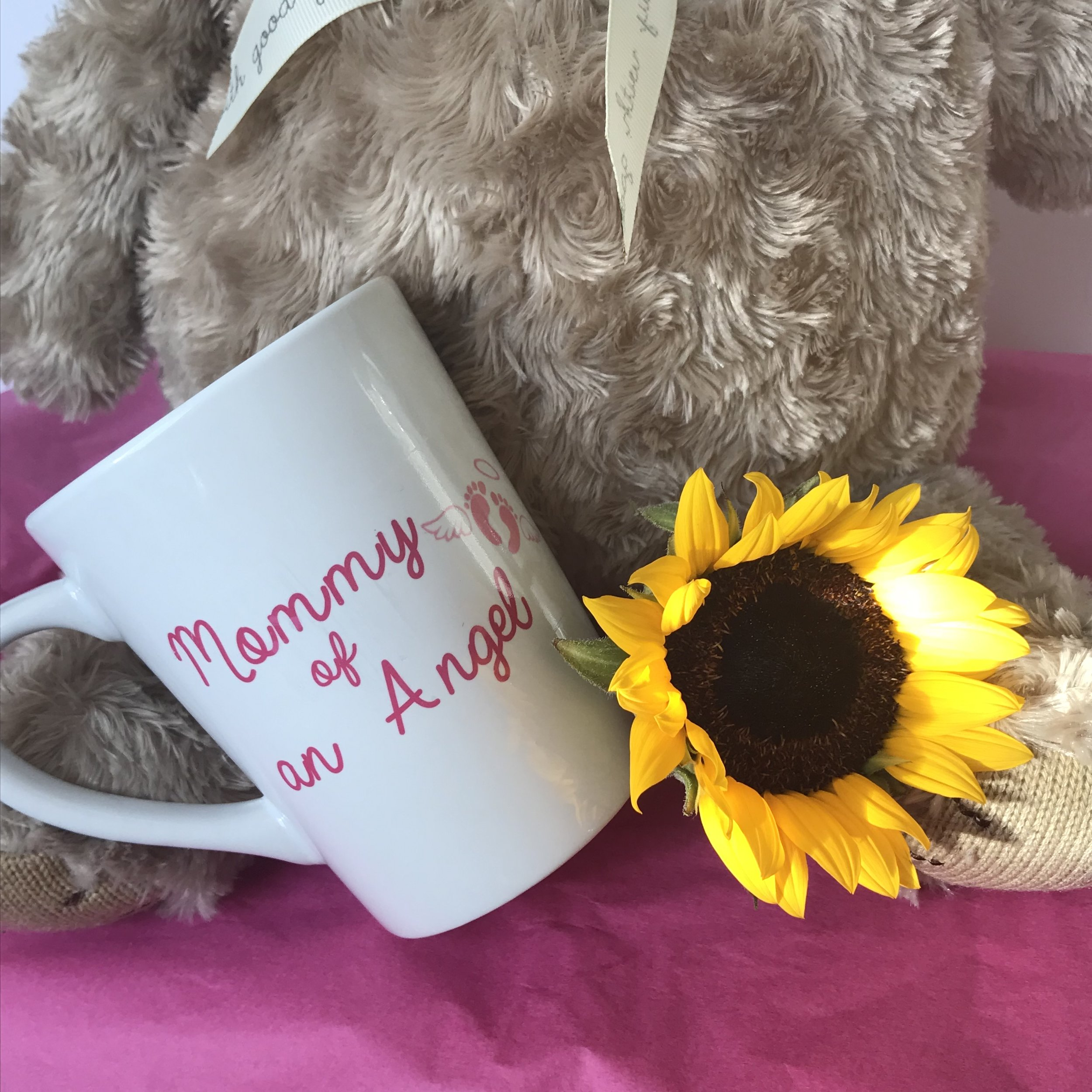 Personalized everyday gift: - If you're stilllMOM is a coffee or tea lover, gift her an Angel mommy coffee mug from Sippin Tee LLC or request to create a custom mug.