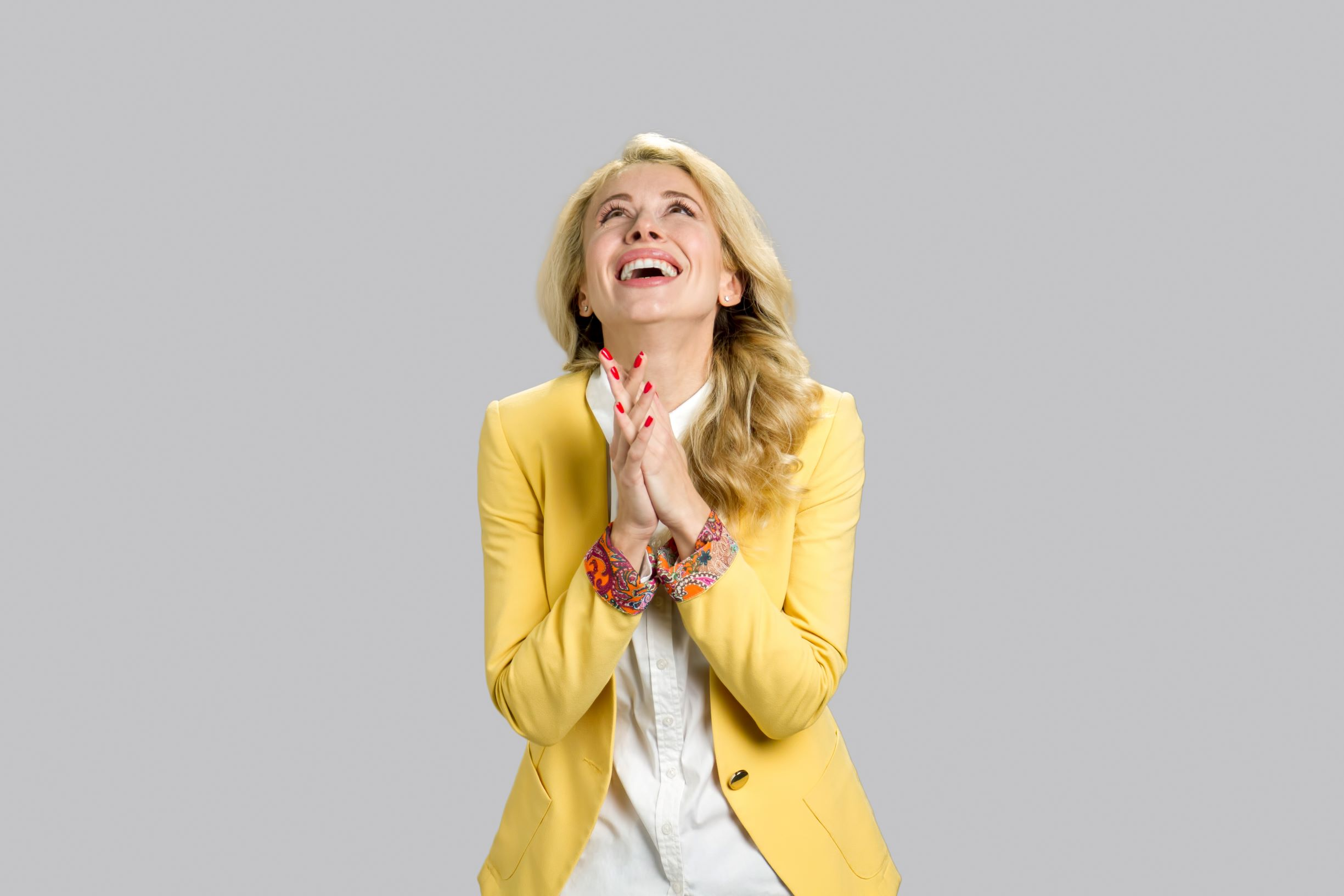 young woman happy gratitude blond hair yellow jacket.jpeg