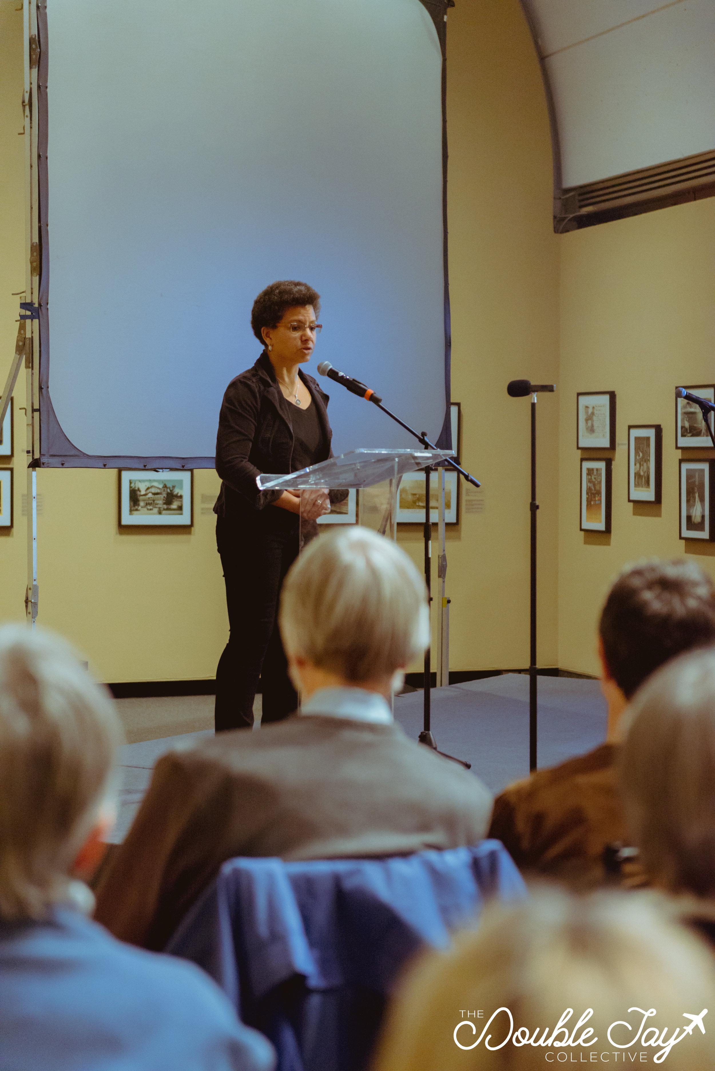 Datejie Green gives a heartfelt welcome to keynote speaker, Dr. Vandana Shiva.