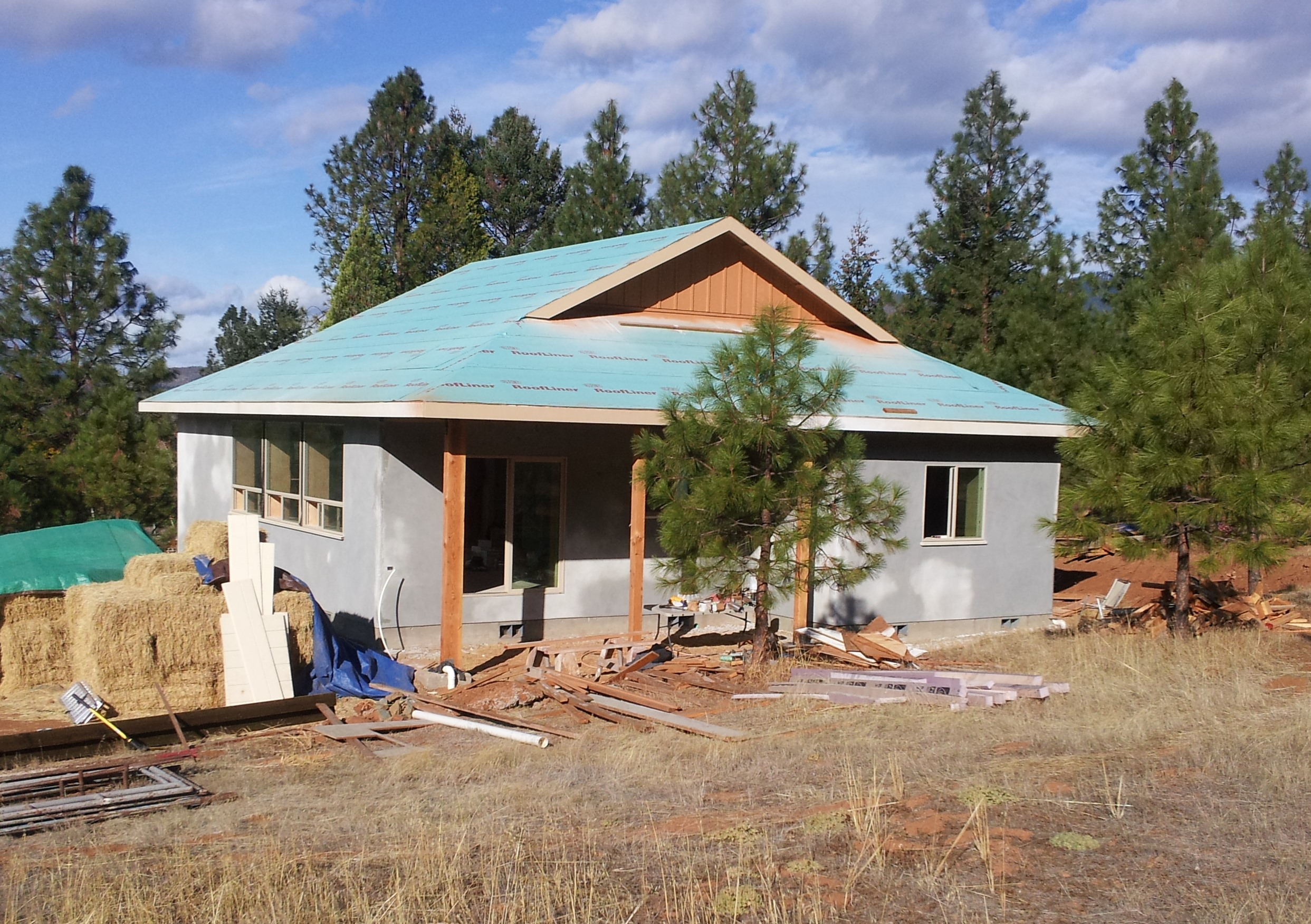 Lime plastered exterior of passive solar straw bale home.