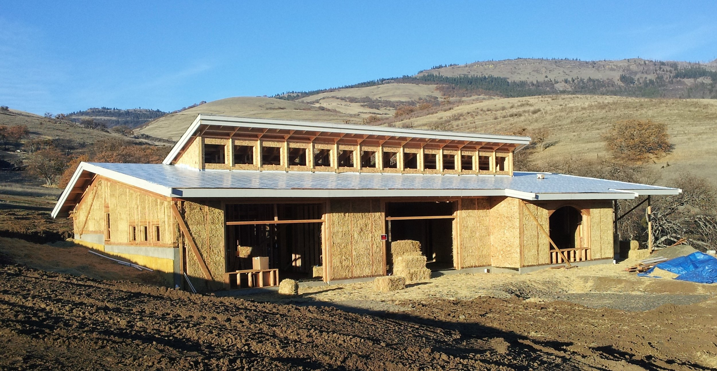 Passive solar straw bale house uses both straw bale shear wall and interior partition shear walls.  Lime exterior and interior plasters.