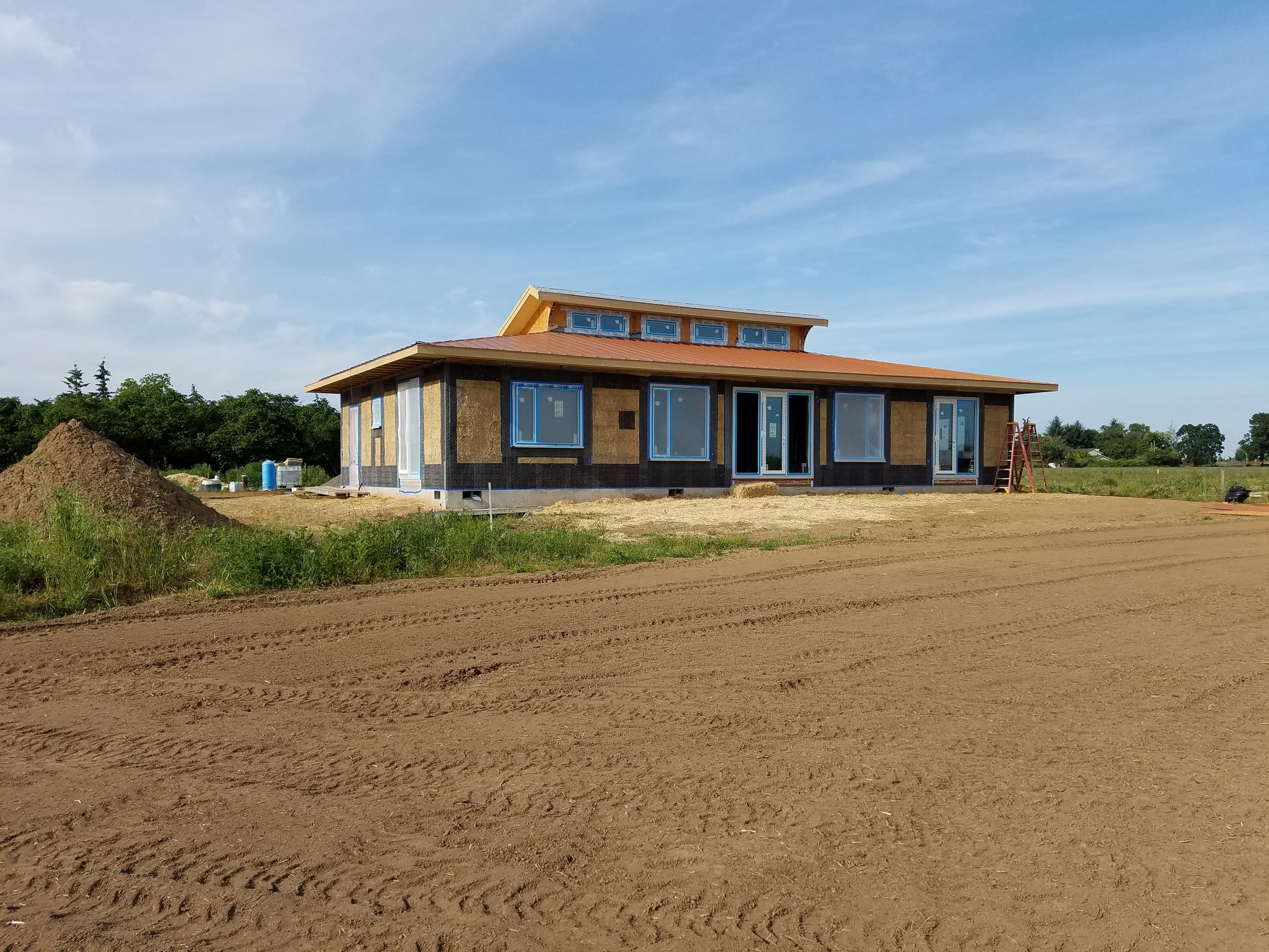 Passive solar straw bale home uses straw bale shear wall and interior partition shear walls.  Lime exterior and interior plasters.