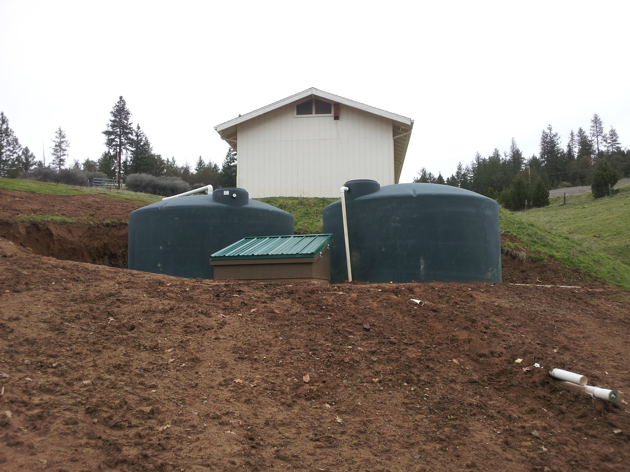 10,000 gallon system collects water from barn roof.  Pump house protects pump and pressure tank.
