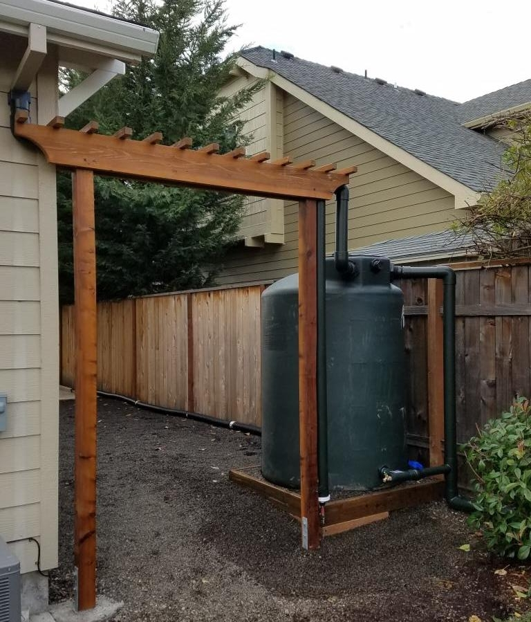 500 gallon system with gutter screens, first flush, overflow and outlet.  Trellis carries inlet pipe, supports first flush.