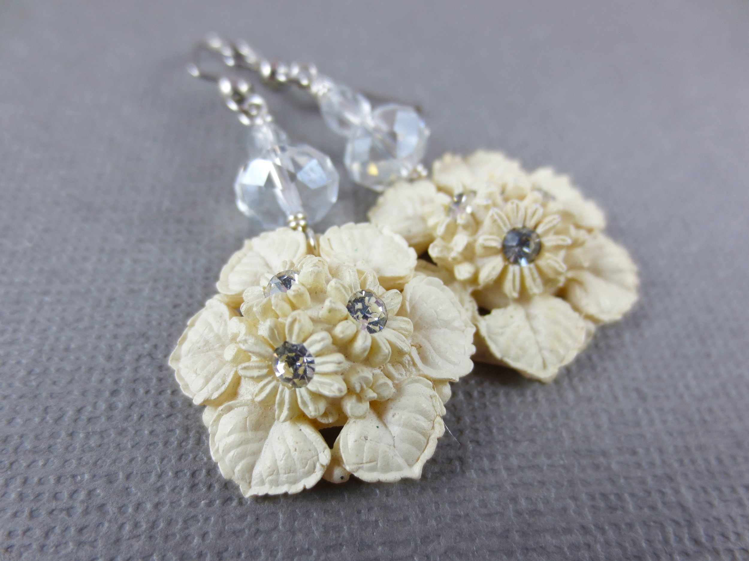 Off-white flower earrings with rhinestone accents