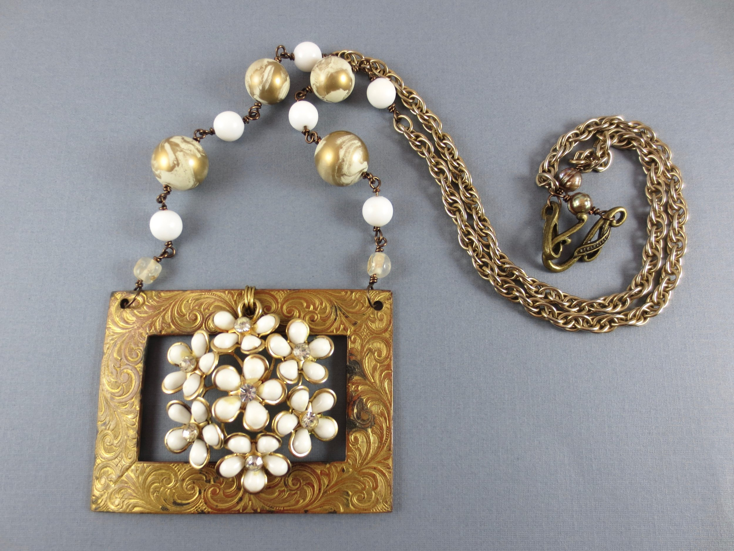 1950s, 1960s, and 1970s jewelry parts were assembled to make this necklace.