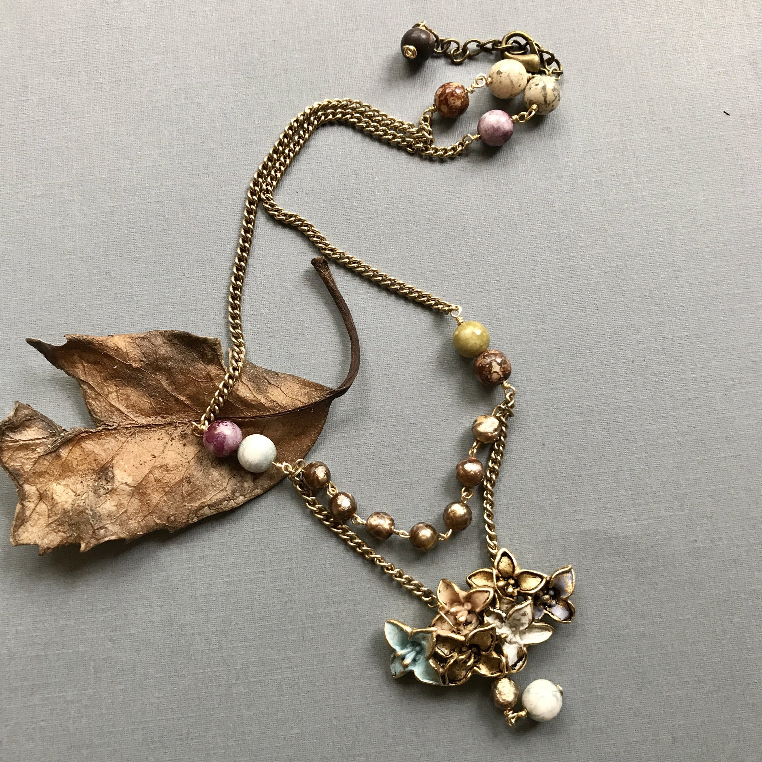 vintage assemblage necklace:  repurposed 1950s clip earring, chain from 1960s necklace, new beads and clasp