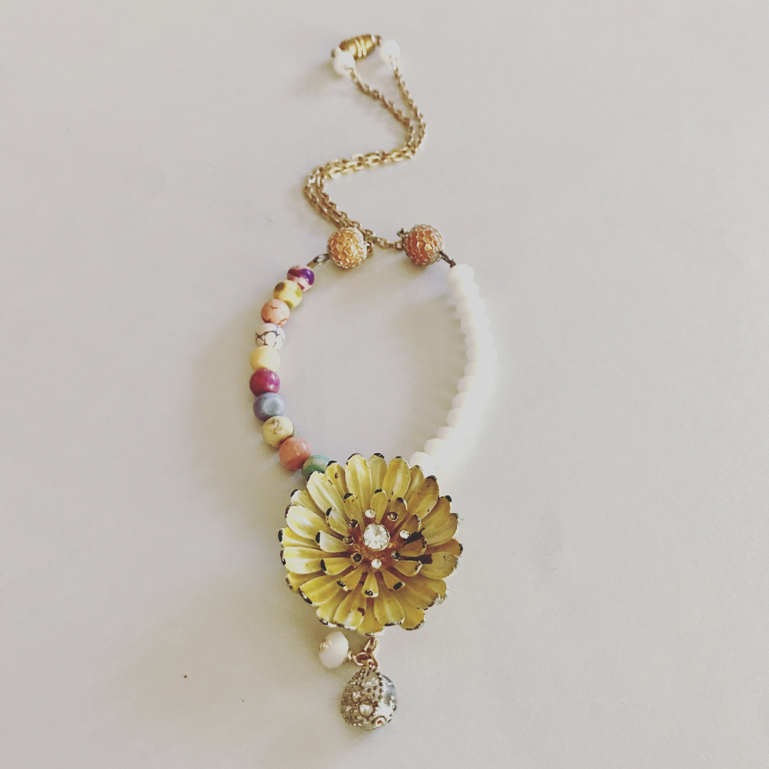 upcycled vintage jewelry:  1950s enamel flower pin + 1970s goldtone chain, adorned with modern beads and clasp