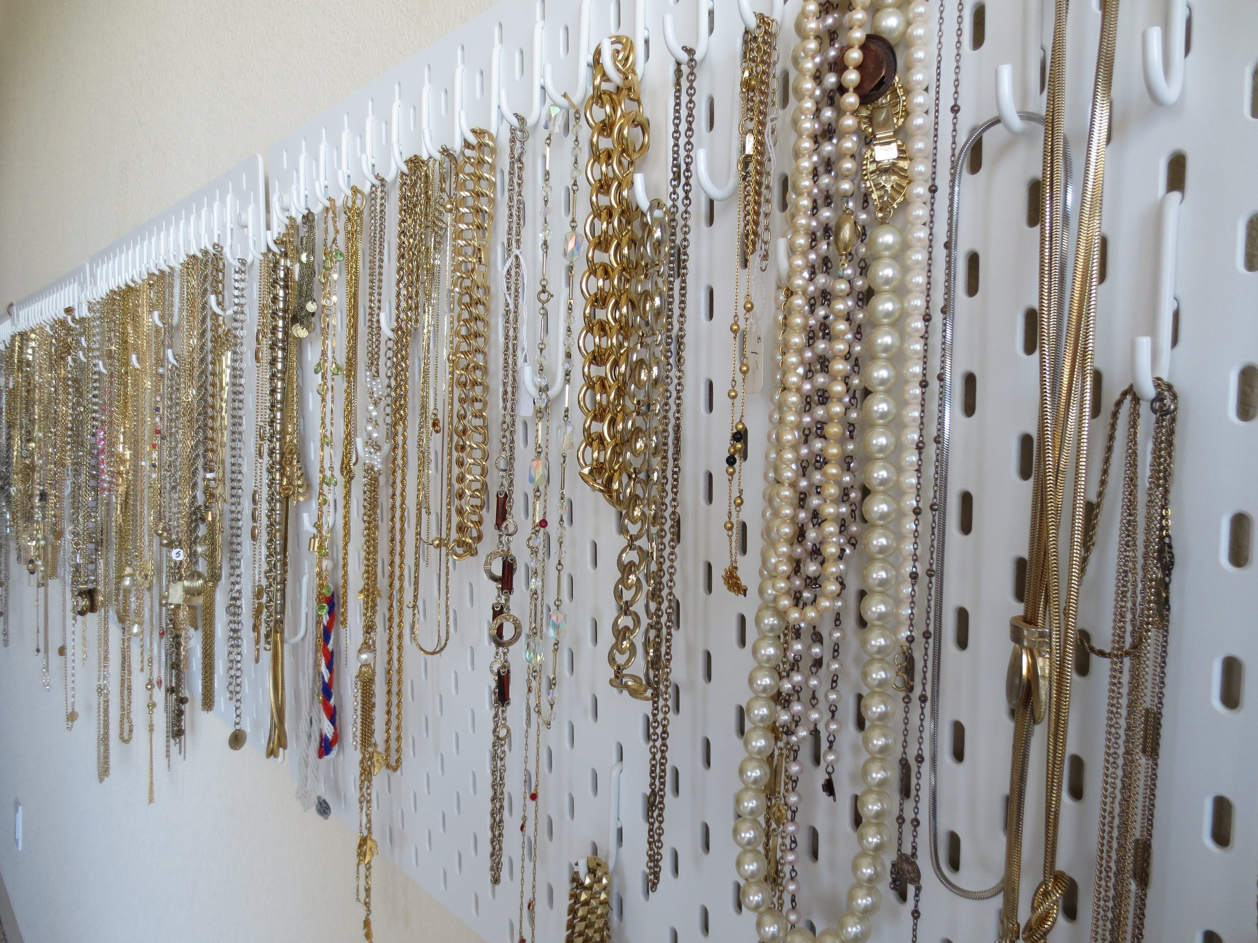 this is the opposite wall with pegboard from IKEA- full of vintage chain
