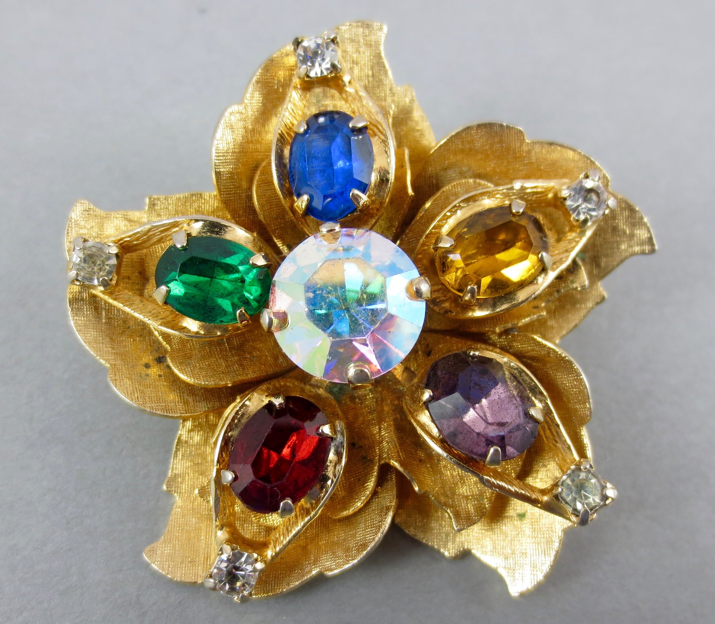 WARNER brooch