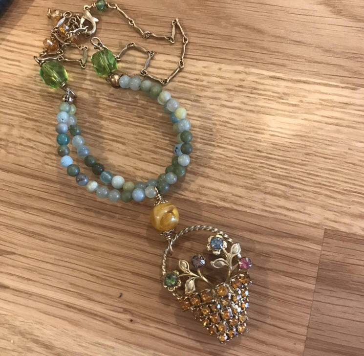 Here's was my first go around with incorporating this sparkly rhinestone flower basket pendant into a necklace. (BEFORE)