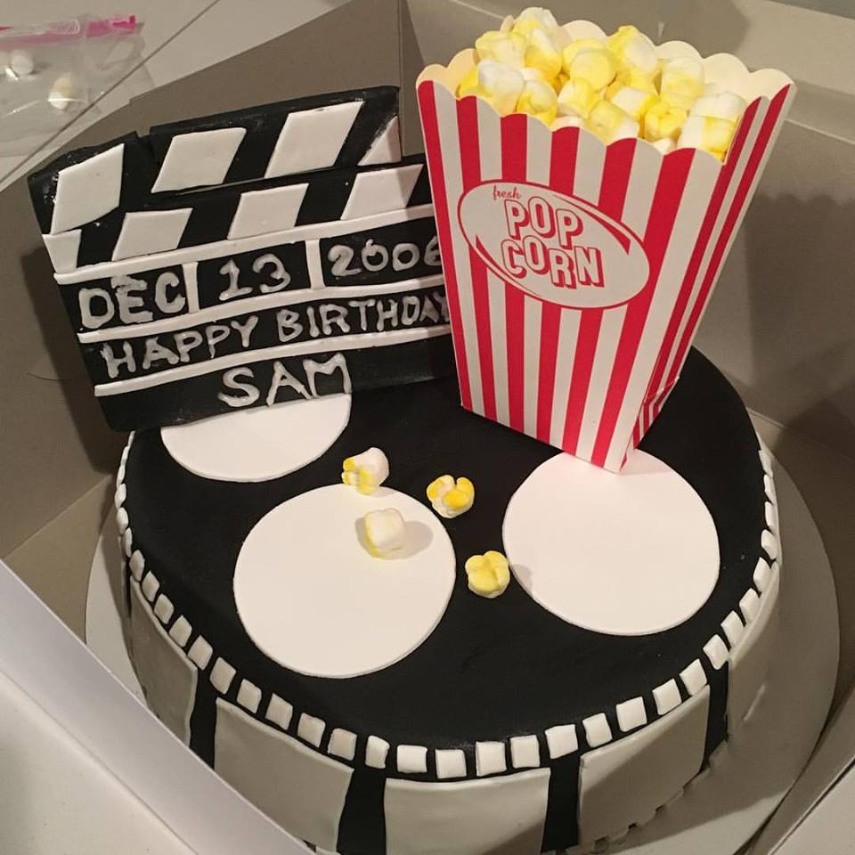 Hollywood cake with popcorn and slateboard clapper
