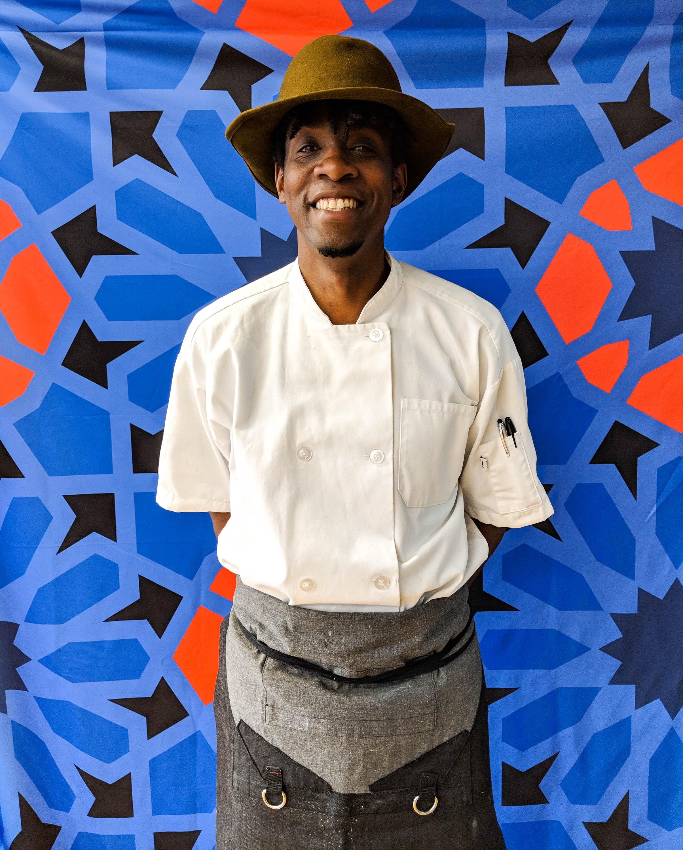Chef Tarik Abdullah beams in front of our new signature 'boharat' pattern.
